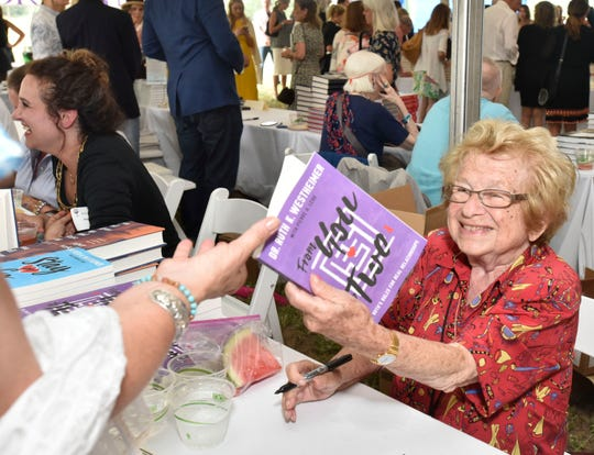 """Dr. Ruth signs copies of her book """"From You to Two"""" at East Hampton (N.Y.) Library in 2018."""