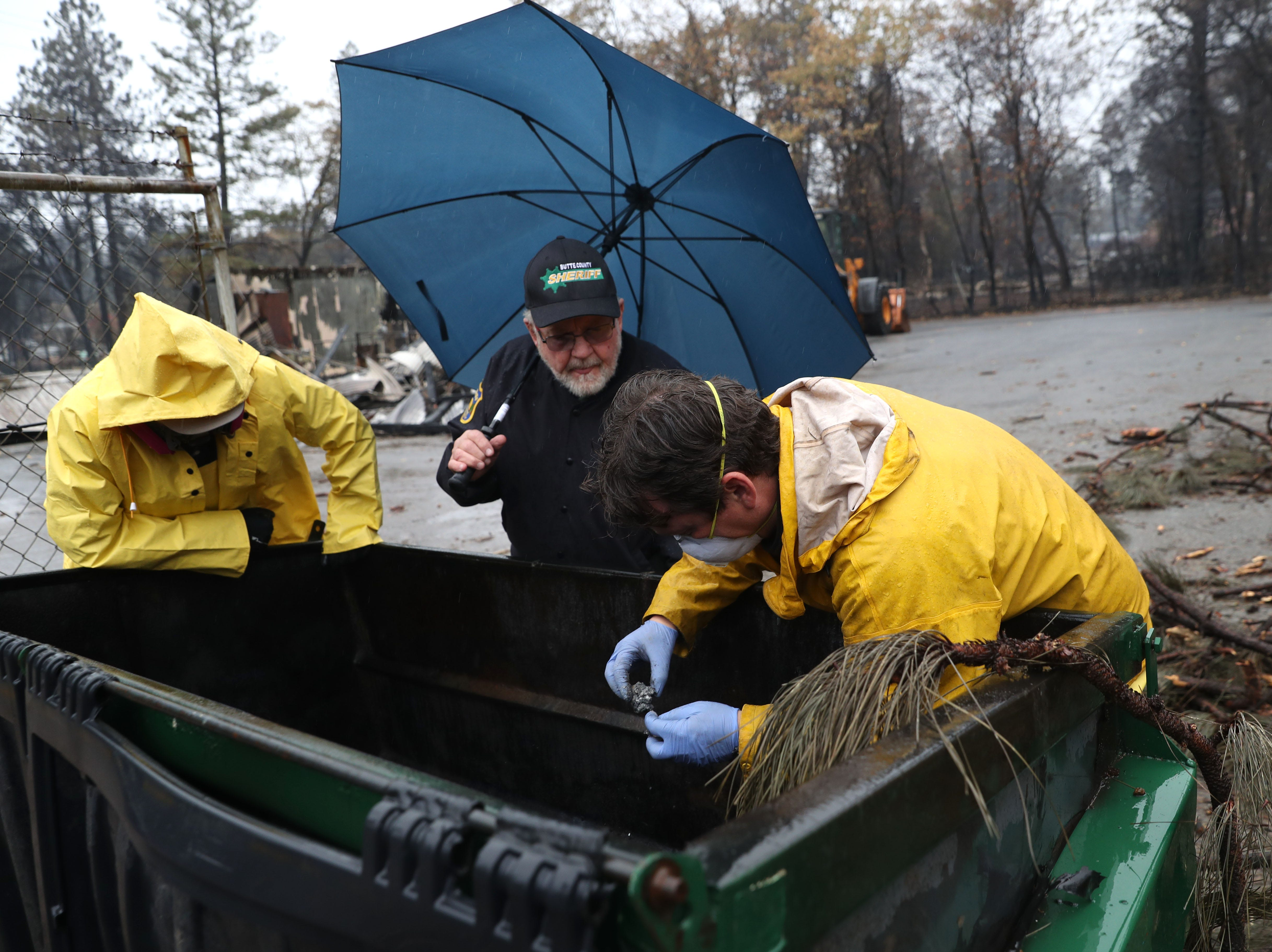 Search and rescue crews dig through dumpster as they search for human remains on November 21, 2018 in Paradise, Calif.