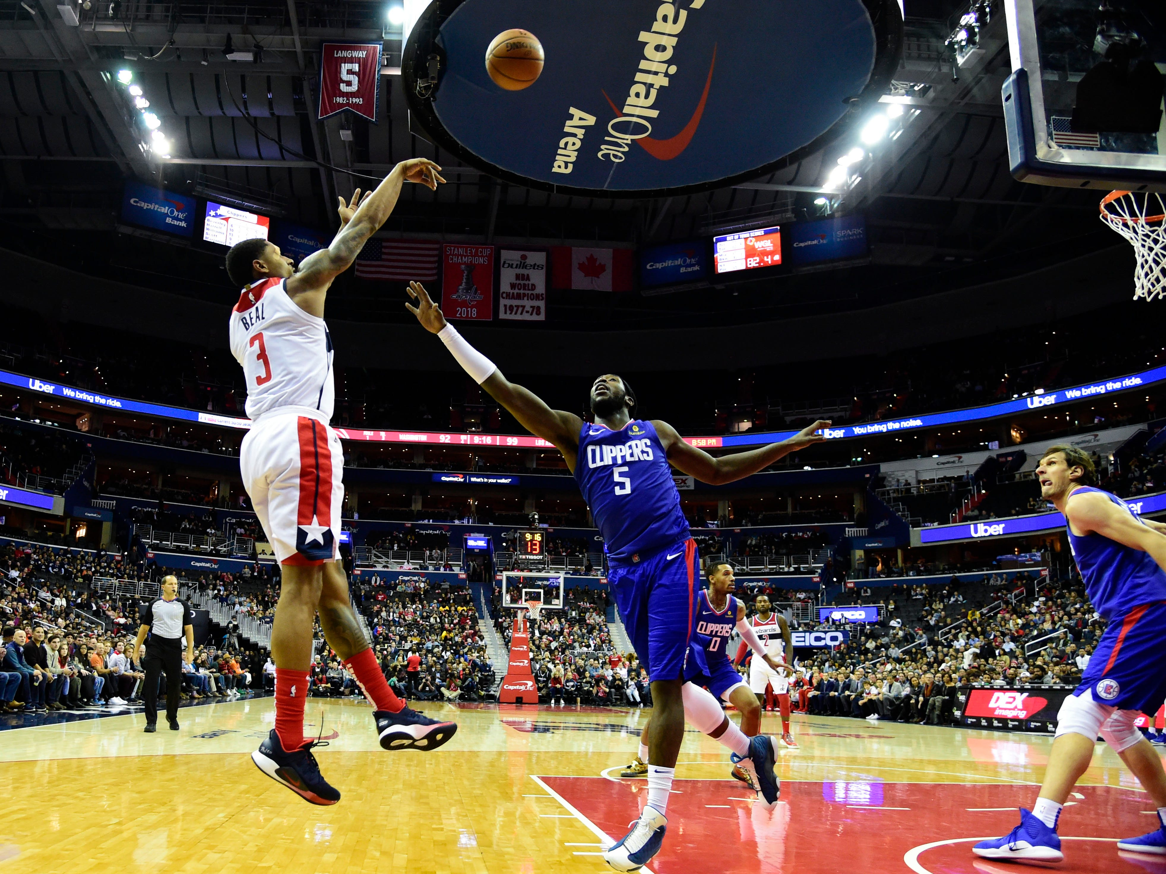 Nov. 20: Wizards guard Bradley Beal shoots over Clippers forward Montrezl Harrell during the fourth quarter at Capital One Arena.