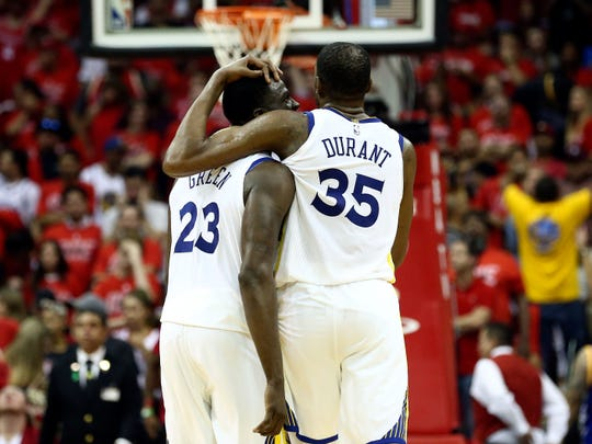 Draymond Green and Kevin Durant hug in the final seconds of Game 7 of the 2018 Western Conference finals.