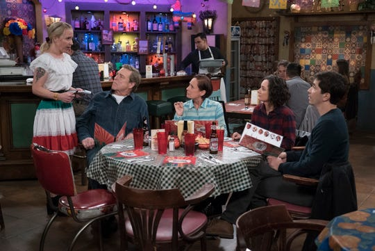A nauseated Becky (Lecy Goranson), left, has trouble taking food orders from her father, Dan (John Goodman), Aunt Jackie (Laurie Metcalf), sister Darlene (Sara Gilbert) and Darlene's boyfriend, Neil (Justin Long), in Tuesday's episode of ABC's 'The Conners.'