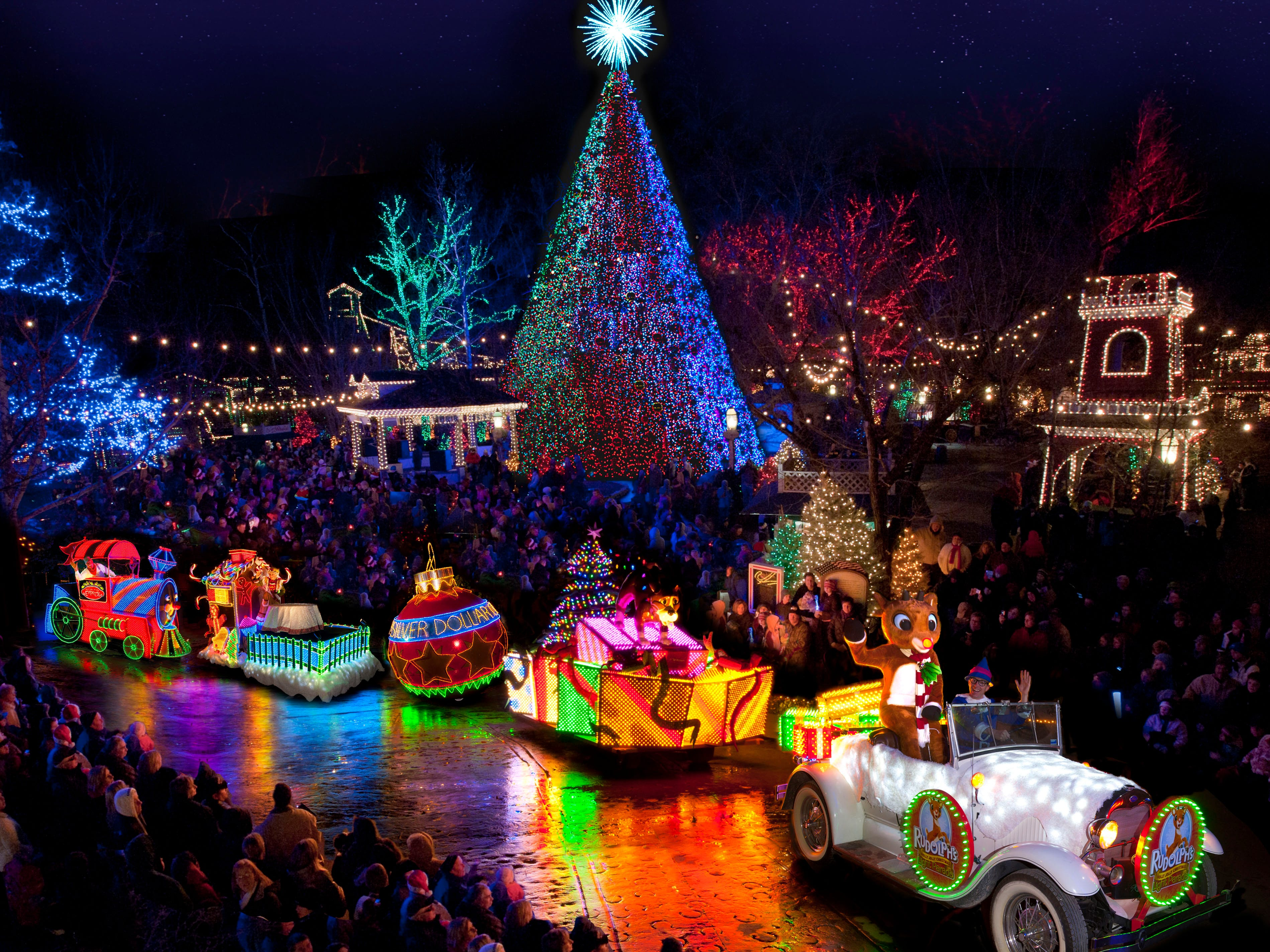 """Twice each evening, the Holly Jolly Light Parade, which features characters and illuminated floats from the beloved stop-motion TV show """"Rudolph the Red-Nosed Reindeer,"""" proceeds around the park and past a 50-foot Christmas tree."""