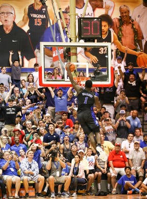 Zion Williamson #1 of the Duke Blue Devils goes up for a dunk off the fast break during the second half of the game against the San Diego State Aztecs.
