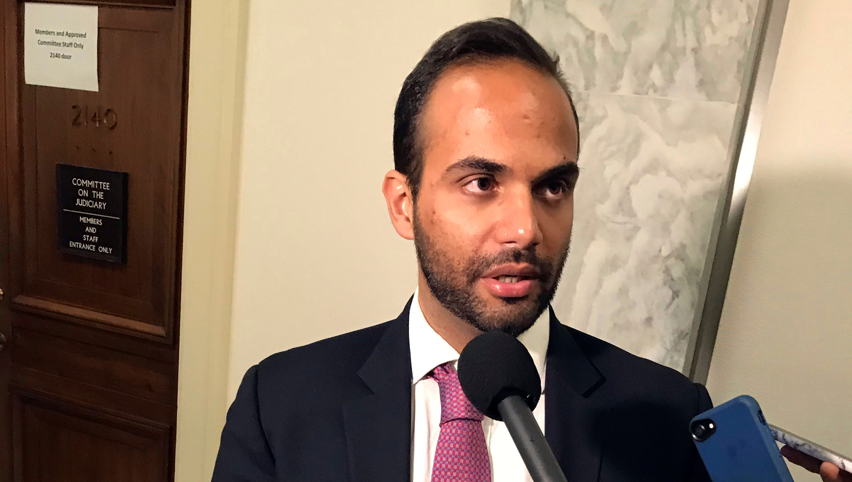 George Papadopoulos, the former Trump campaign adviser who triggered the Russia investigation, talks to reporters after his first appearance before congressional investigators, on Capitol Hill in Washington, Oct. 25, 2018.
