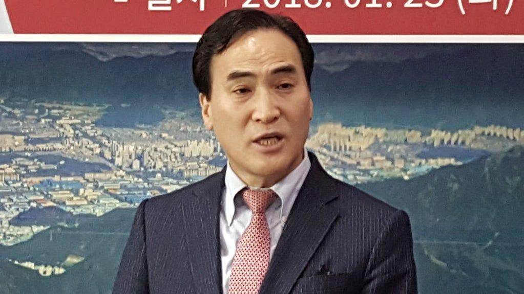 Interpol's new president, Kim Jong Yang. He is from South Korea.