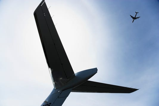 Low Angle View Of Airplane Tail With Airplane In Sky