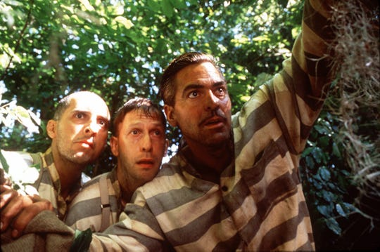 John Turturro, left, Tim Blake Nelson and George Clooney play escaped convicts on the run in the 2000 film, 'O Brother, Where Art Thou?'