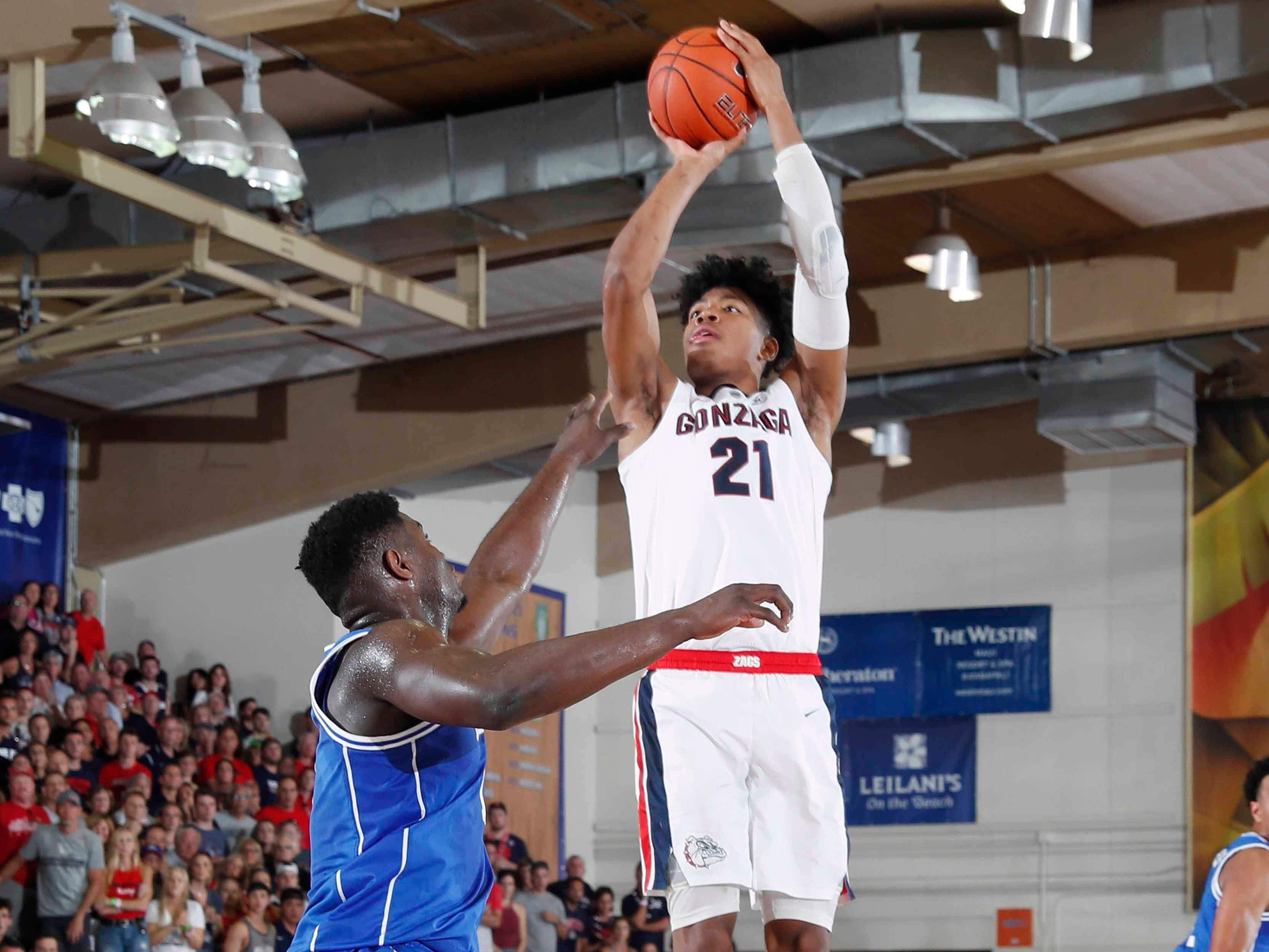 Gonzaga Bulldogs forward Rui Hachimura takes a shot against Duke Blue Devils forward Zion Williamson during the championship game of the Maui Jim Maui Invitational.
