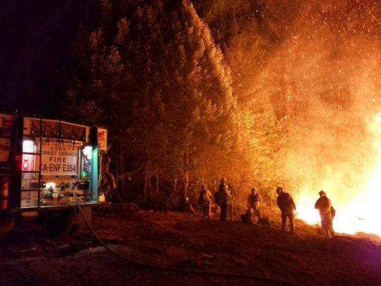 An undated handout photo made available by the United States Forest Service  and the National Wildfire Coordinating Group on Inciweb on November 20, 2018 shows firefighters battling the Camp Fire in Northern California.