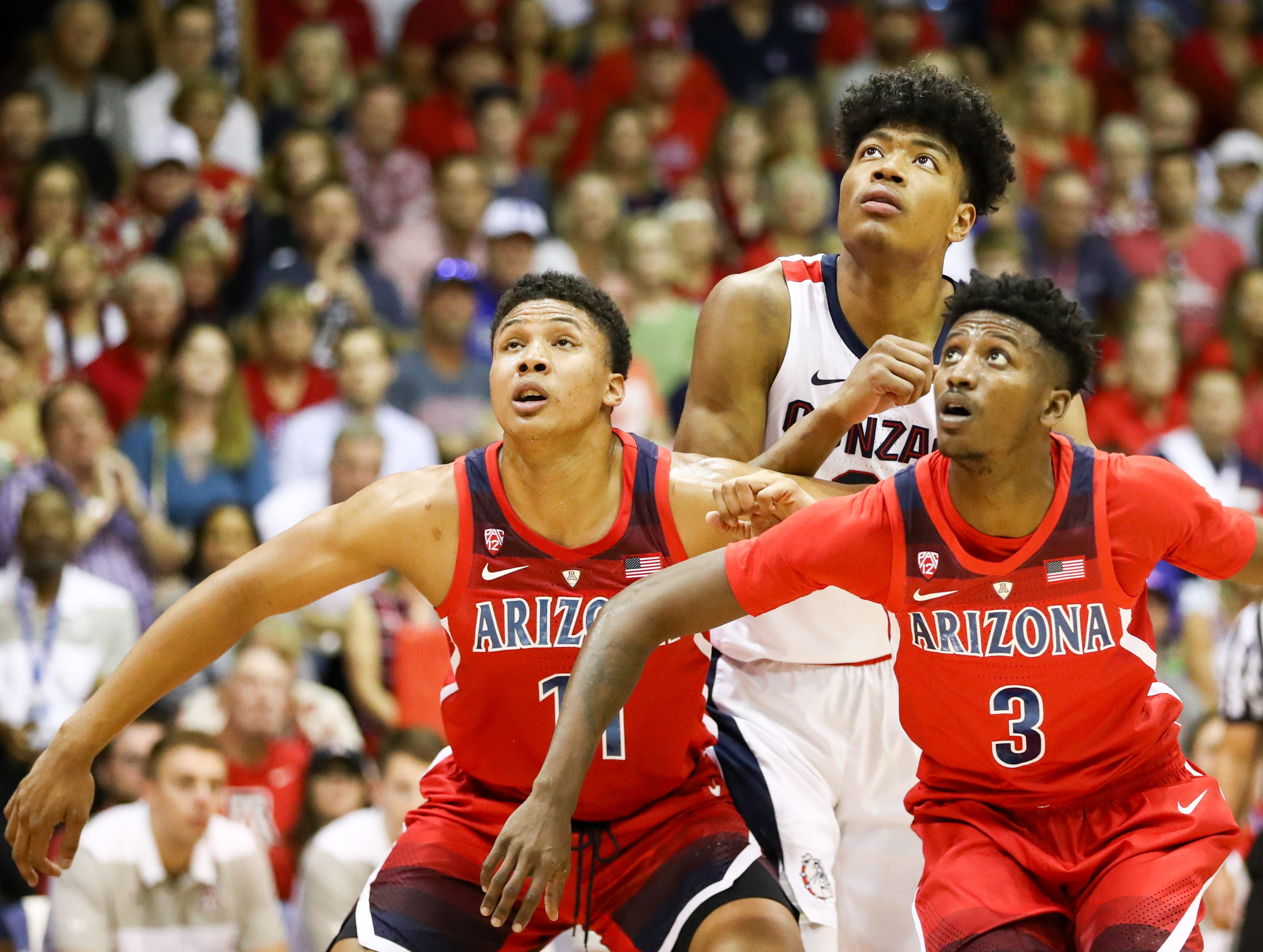 Ira Lee and Dylan Smith of the Arizona Wildcats block out Rui Hachimura of the Gonzaga Bulldogs during a free throw attempt during the first half of the game at the Lahaina Civic Center.
