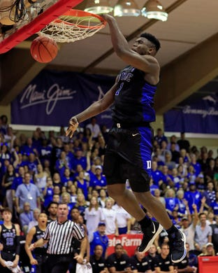 Zion Williamson (1) slam-dunks over San Diego State during the second half of an NCAA college basketball game at the Maui Invitational.
