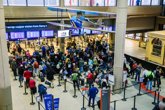 Travelers wait in security lines at the Pittsburgh International Airport on Tuesday, Nov. 20, 2018.