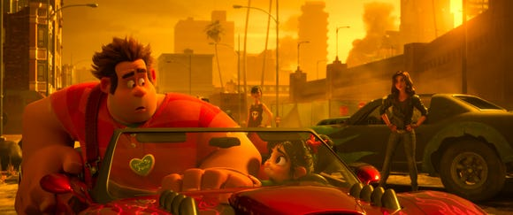 """Ralph (voiced by John C. Reilly, left) and Vanellope (Sarah Silverman) run afoul of Shank (Gal Gadot) and her crew in the game """"Slaughter Race."""""""