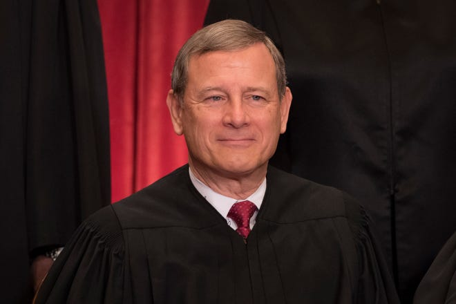 Chief Justice John Roberts poses for a group photo with all nine Supreme Court Justices in the East Conference Room of the Supreme Court Building in Washington on June 1, 2017.