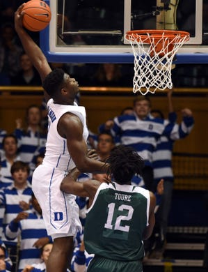 Nov 14, 2018; Durham, NC, USA; Duke Blue Devils forward Zion Williamson (1) dunks in front of Eastern Michigan Eagles center Boubacar Toure (12) during the first half at Cameron Indoor Stadium.