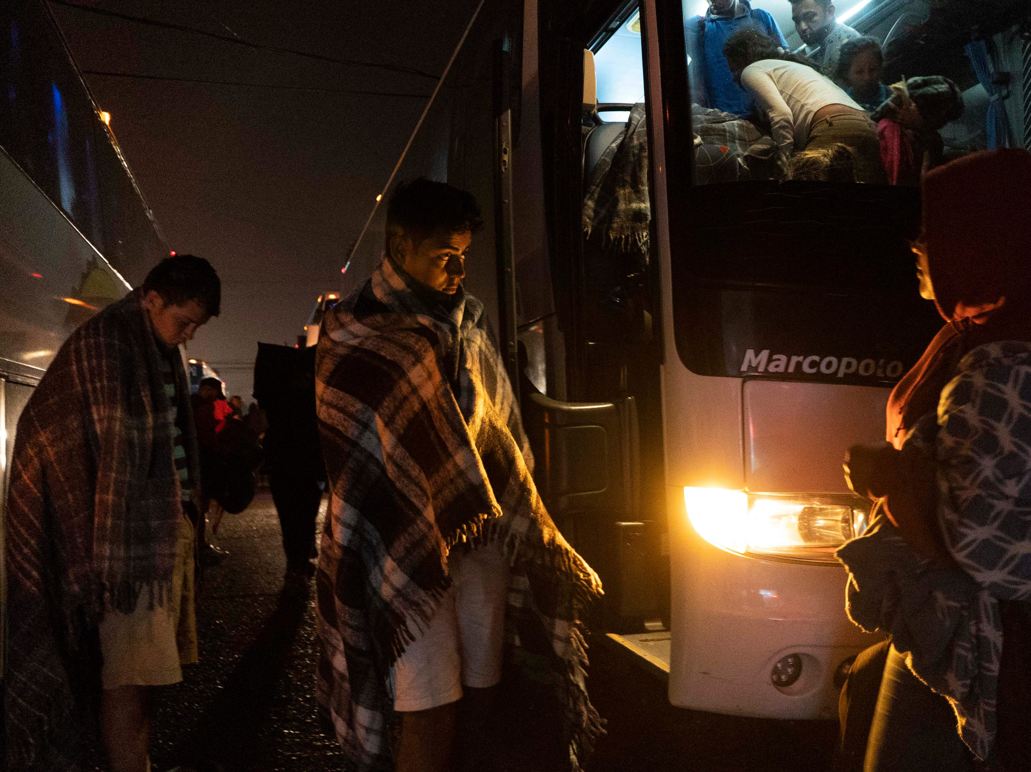 Several charter buses carrying migrants arrive at the Unidad Deportiva Benito Juarez sports complex in Tijuana, Mexico in the early morning hours on Nov. 21, 2018. The city of Tijuana is using the sports complex as a shelter for the migrants.