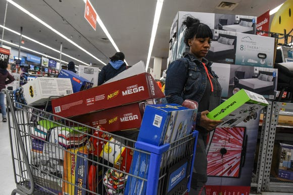 A woman shops at Walmart near the Green Acres Mall in Valley Stream, N.Y.