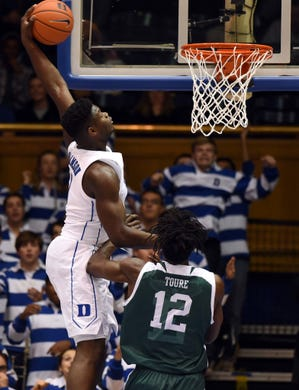 Zion Williamson (1) dunks in front of Eastern Michigan Eagles center Boubacar Toure (12) during the first half at Cameron Indoor Stadium.