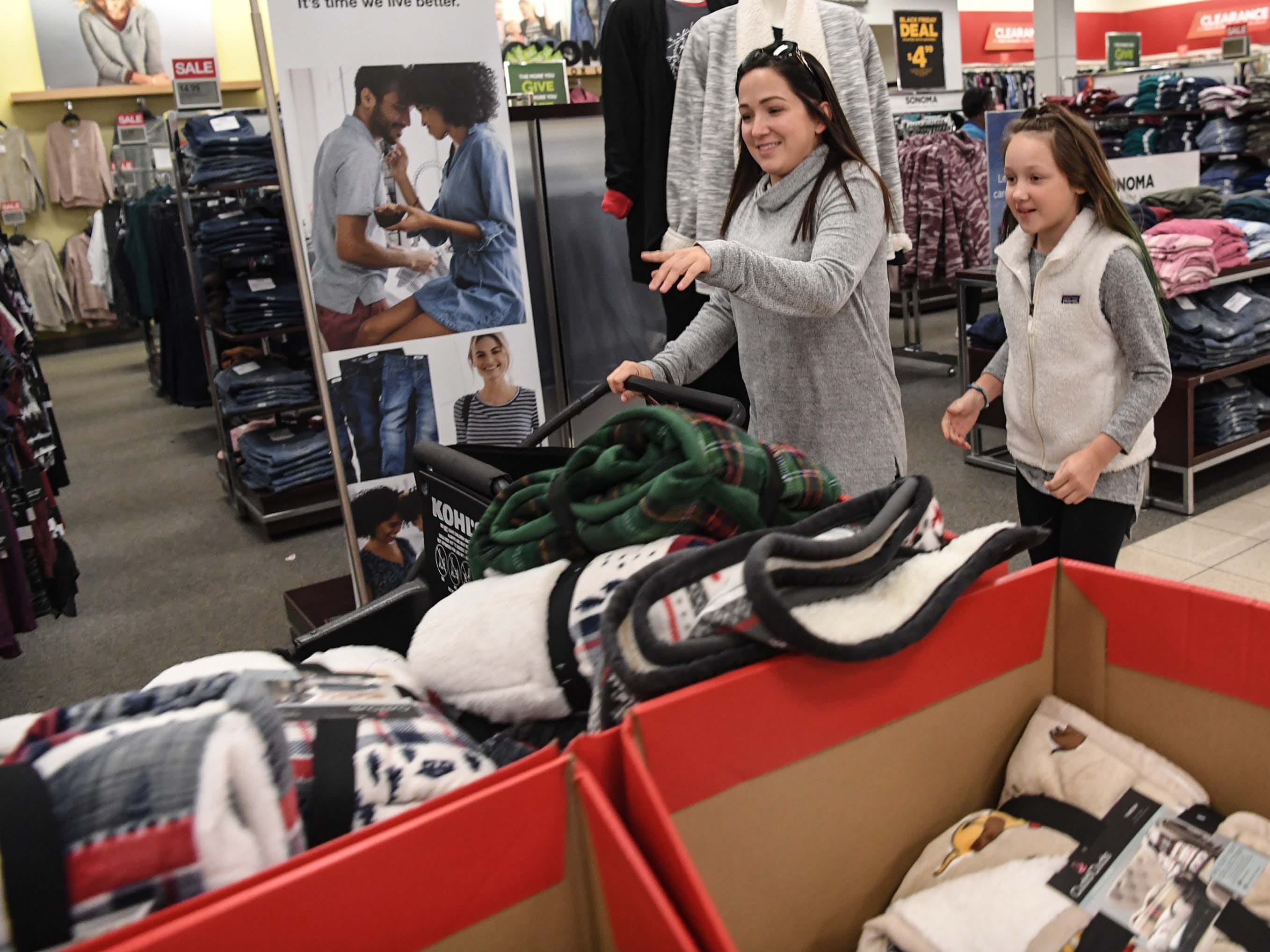 Victoria Bonnette, left, and her daughter Lilah Bonette, first in line, move quickly through isles during Black Friday sales at Kohl's in Anderson on Thanksgiving Day, Thursday, November 22, 2018.