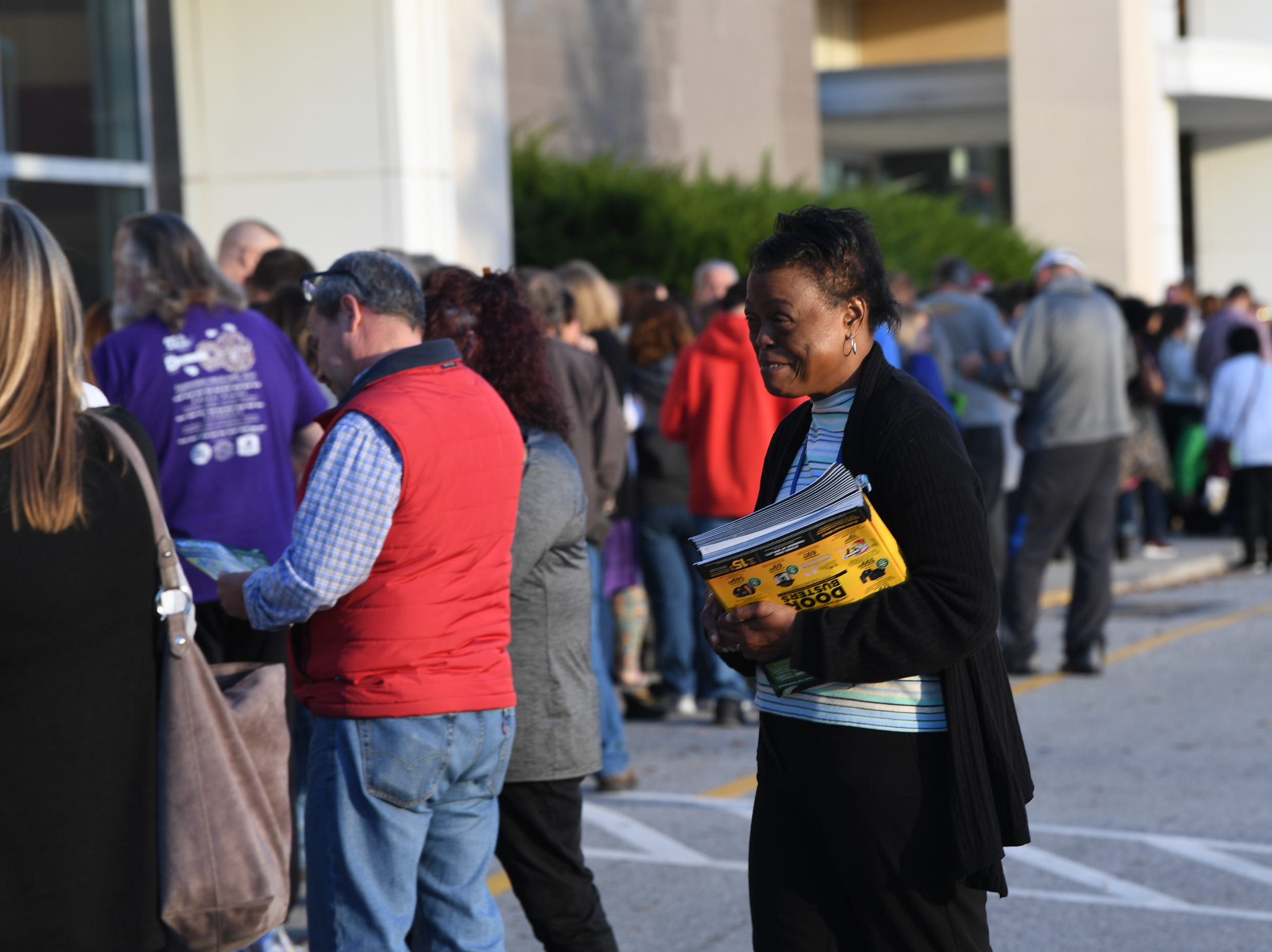 Giselle Boyd, a sales associate for Kohl's in Anderson helps customers before doors open for Black Friday sales at Kohl's in Anderson on Thanksgiving Day, Thursday, November 22, 2018.