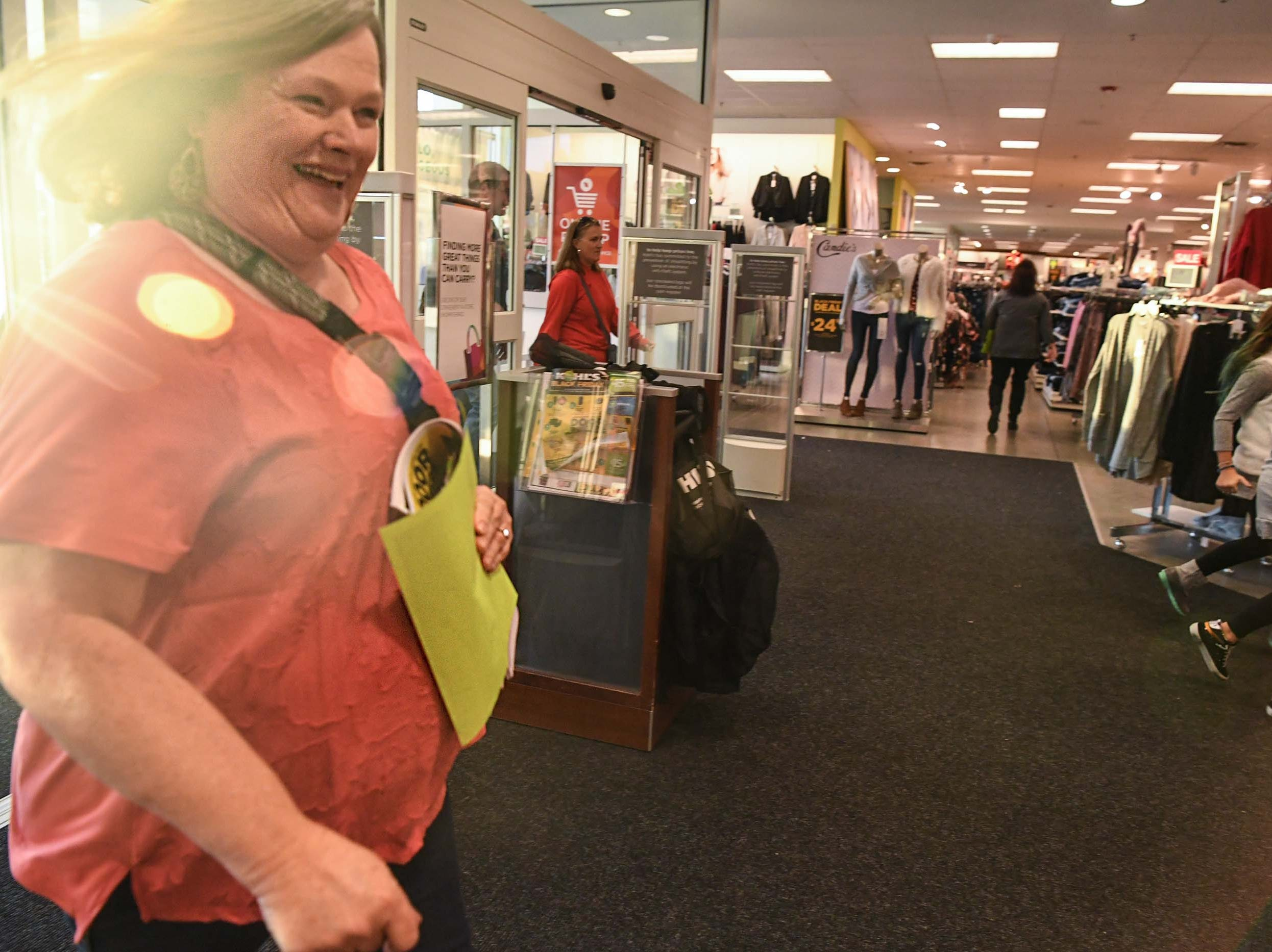 Customers walk quickly through doors for Black Friday sales at Kohl's in Anderson on Thanksgiving Day, Thursday, November 22, 2018.