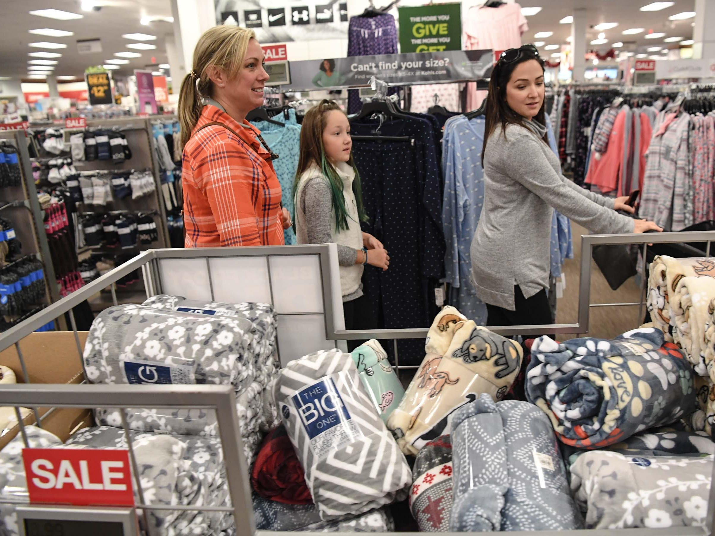 Sunny Davis, left, Lilah Bonnette, and her mother Victoria Bonnette move quickly through isles during Black Friday sales at Kohl's in Anderson on Thanksgiving Day, Thursday, November 22, 2018.