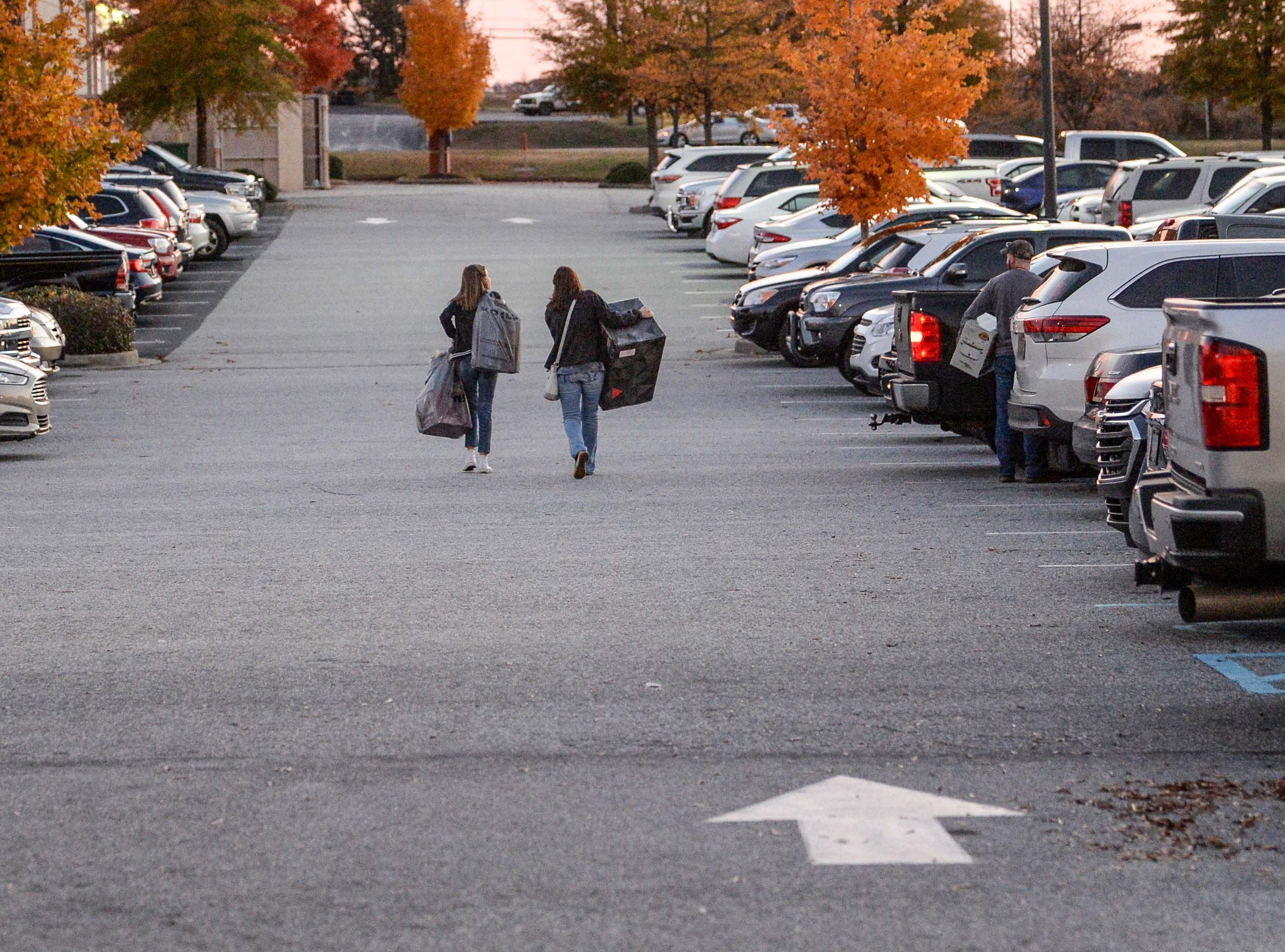 Customers leave Kohl's in Anderson with sale items on Thanksgiving Day, Thursday, November 22, 2018.