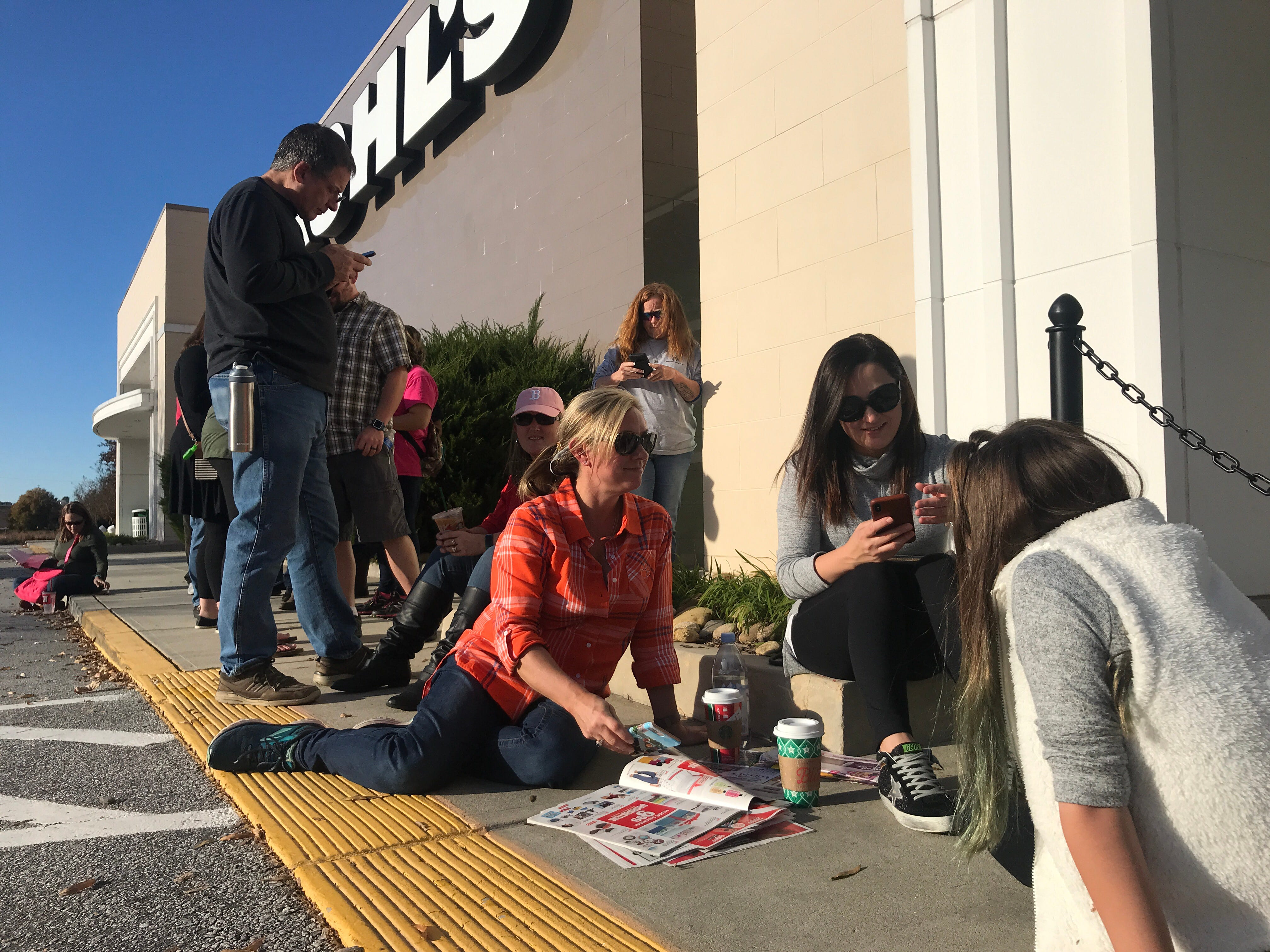 From left, Kohl's Black Friday Thanksgiving Day shoppers Sunny Davis, Victoria Bonnette, and daughter Lilah Bonnette all of Anderson wait for the 5 pm opening looking through newspaper ads.