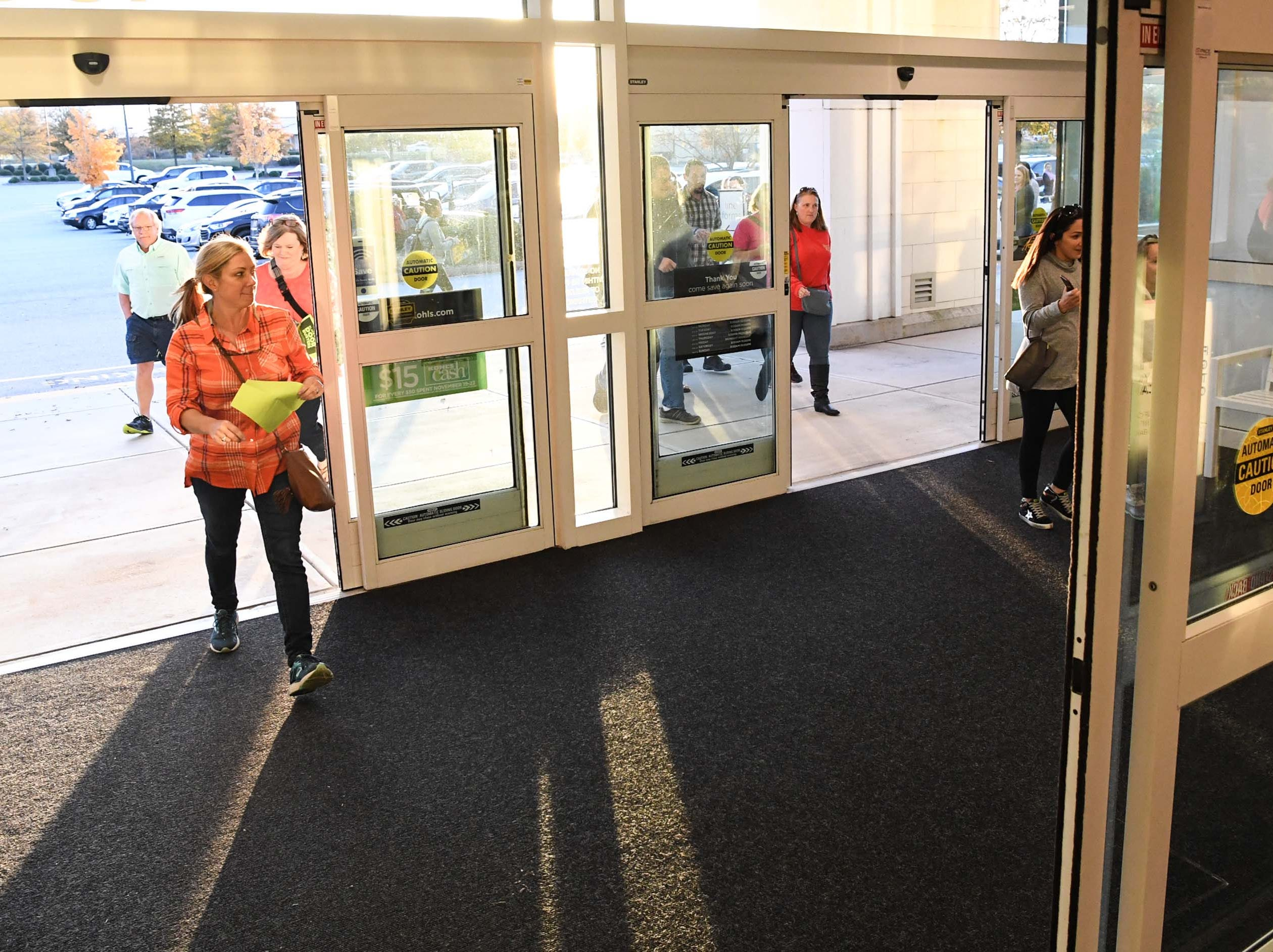 Sunny Davis, left, and Victoria Bonnette walk quickly through doors for Black Friday sales at Kohl's in Anderson on Thanksgiving Day, Thursday, November 22, 2018.