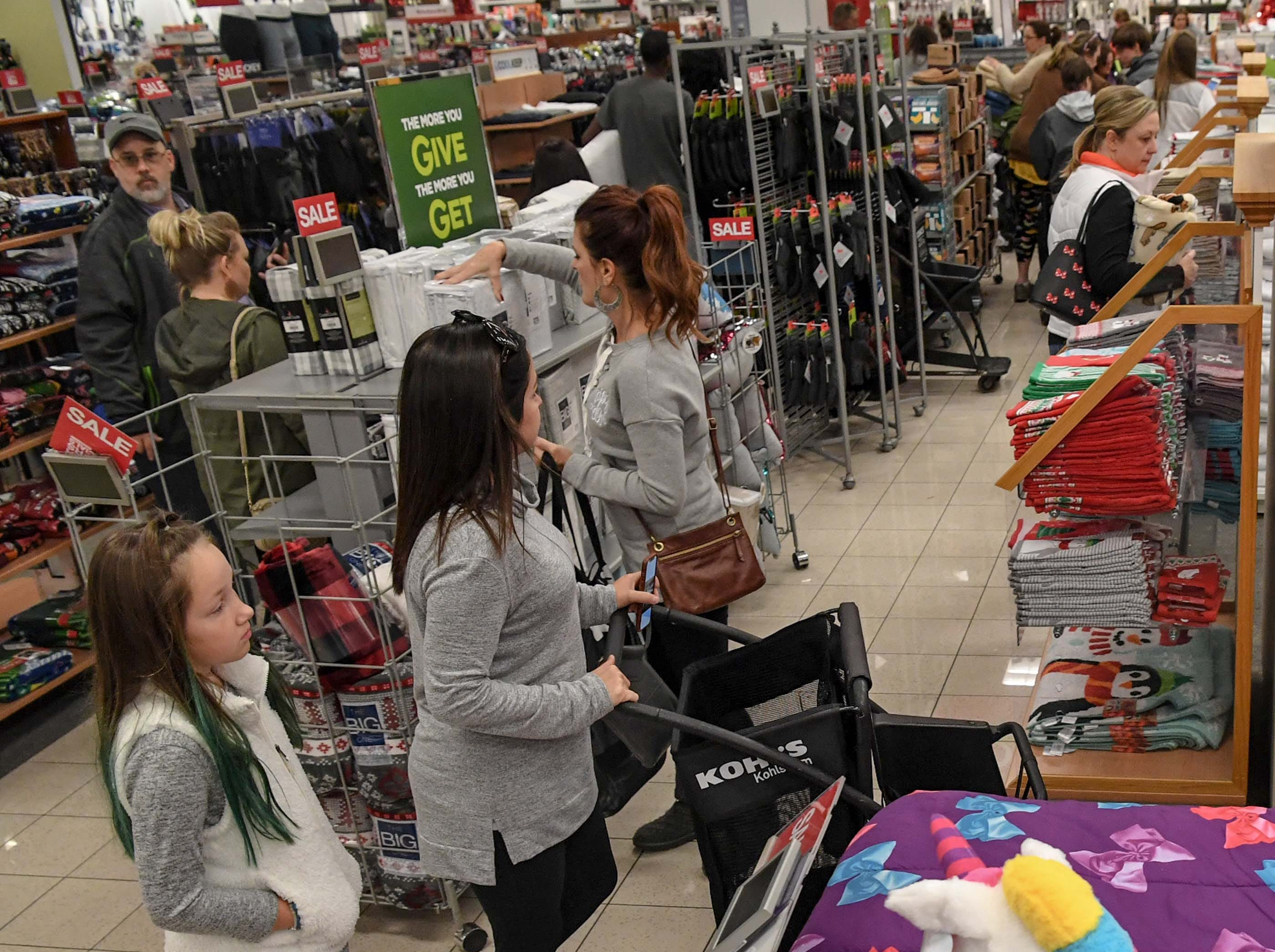Lilah Bonette, left, and her mother Victoria Bonnette, first in line, move quickly through isles during Black Friday sales at Kohl's in Anderson on Thanksgiving Day, Thursday, November 22, 2018.