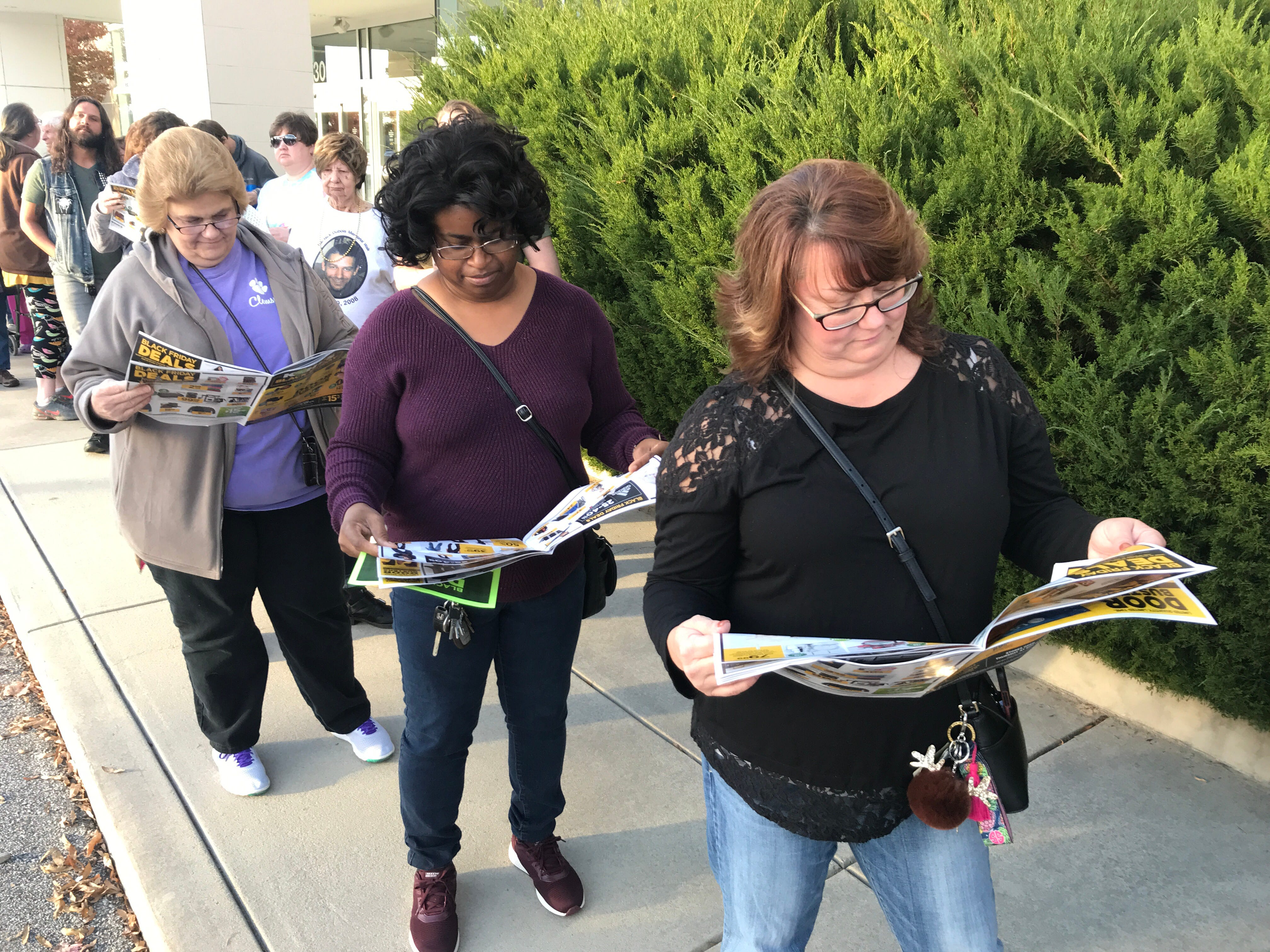 Patti Hipps, Sandy Glaze, and Leann Ramsey wait for Kohl's in Anderson to open for Thanksgiving Day Black Friday sales.