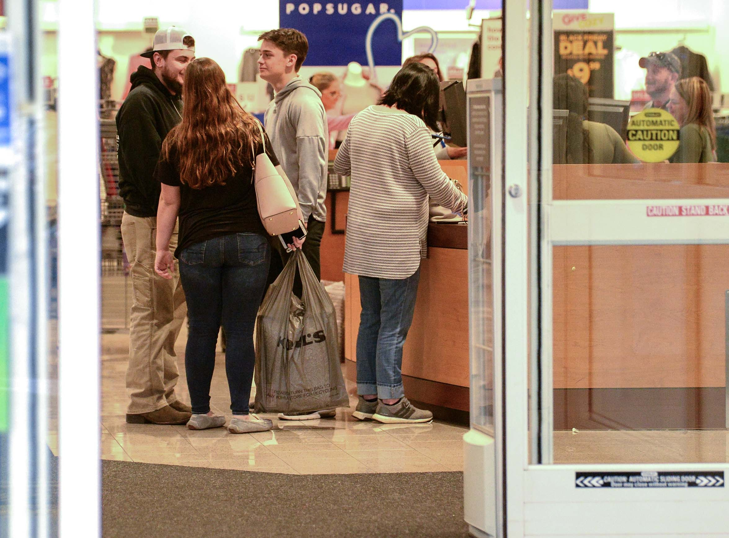 People check out at a register during Black Friday shopping at Kohl's in Anderson on Thanksgiving Day, Thursday, November 22, 2018.