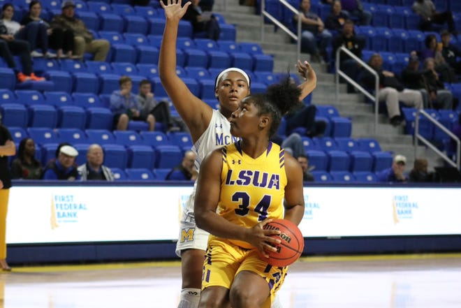 LSUA freshman Aja Law goes up for two points against McNeese on Wednesday.