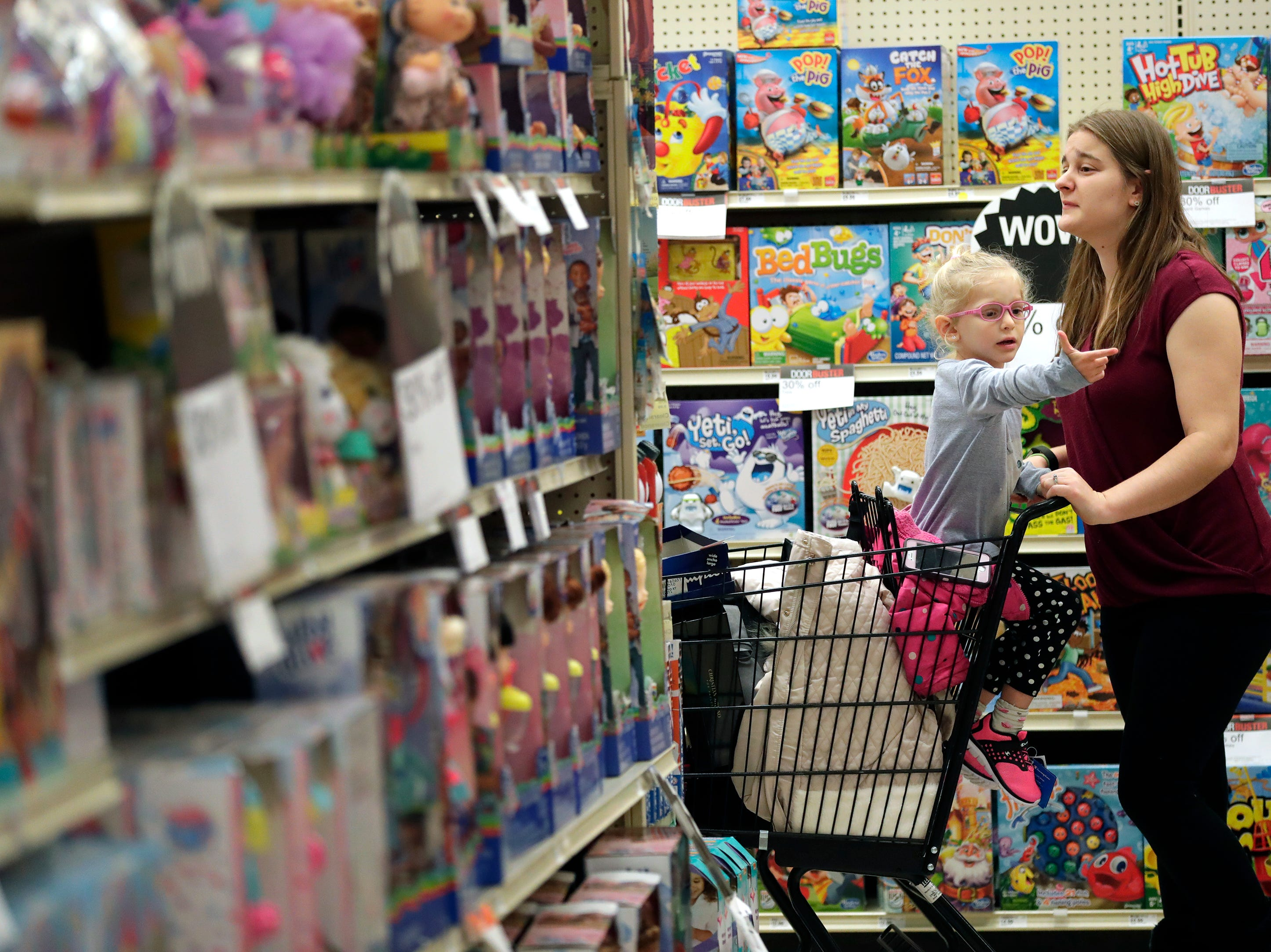 Amber Schallitz, left, and her daughter Zoey, 3, shop in the toy section while looking for Black Friday deals at Shopko Thursday, November 22, 2018, in Appleton, Wis. The two are from Grafton.