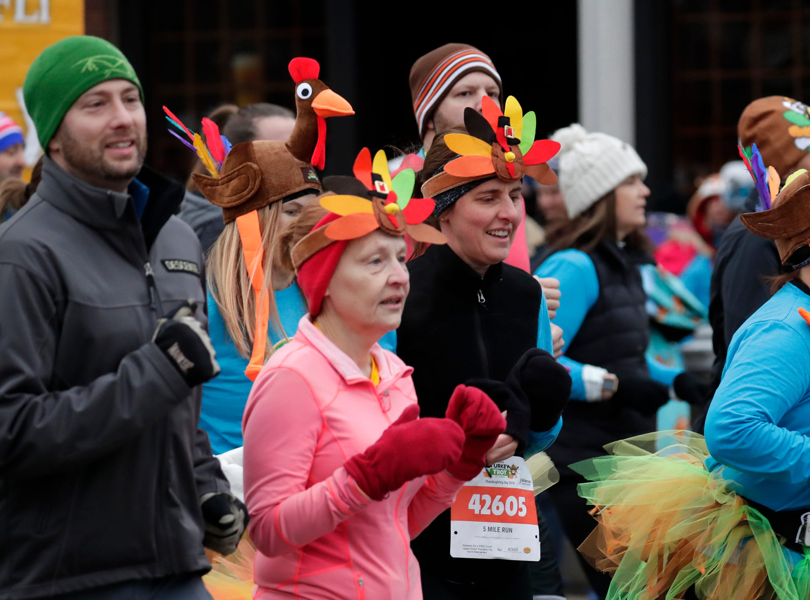 People participate in 11th Annual Festival Foods Turkey Trot Thursday, November 22, 2018, in Appleton, Wis. 