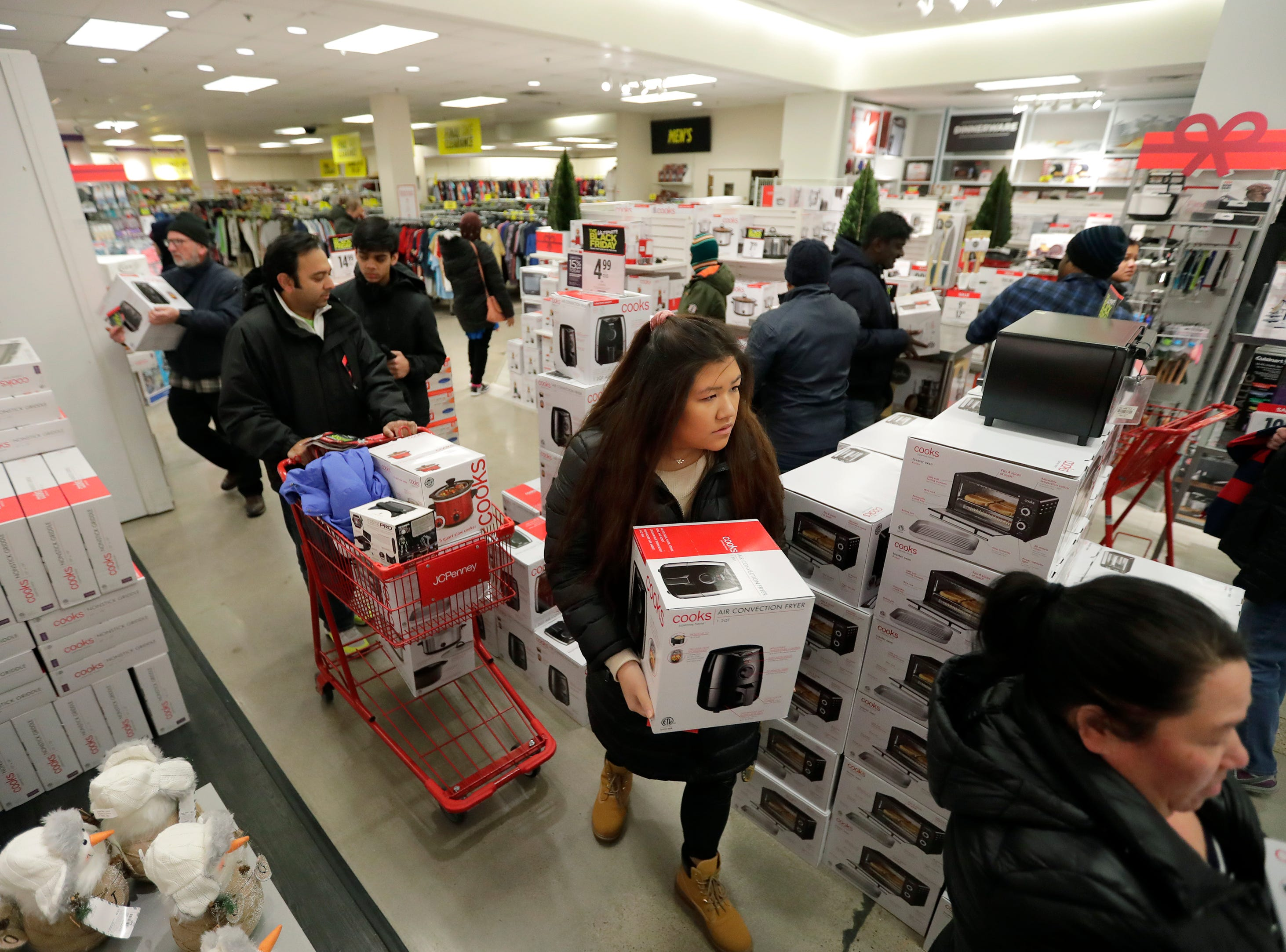 Customers look for Black Friday deals at JCPenney Thursday, November 22, 2018, in Grand Chute, Wis. 