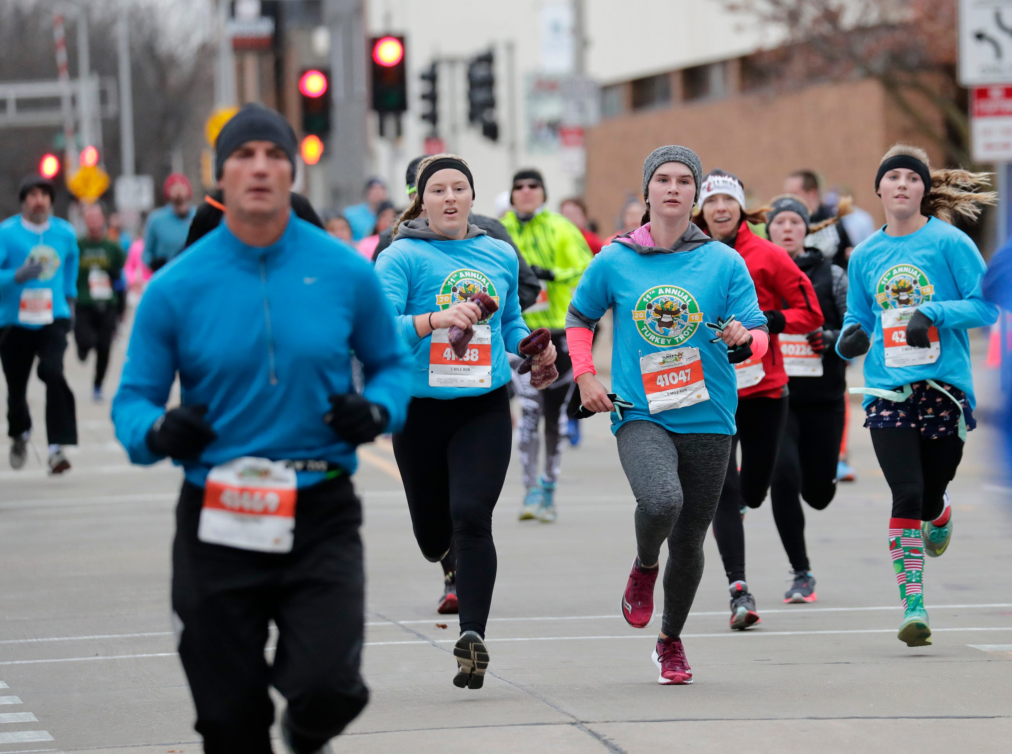 People particpate in the 11th Annual Festival Foods Turkey Trot Thursday, November 22, 2018, in Appleton, Wis. 