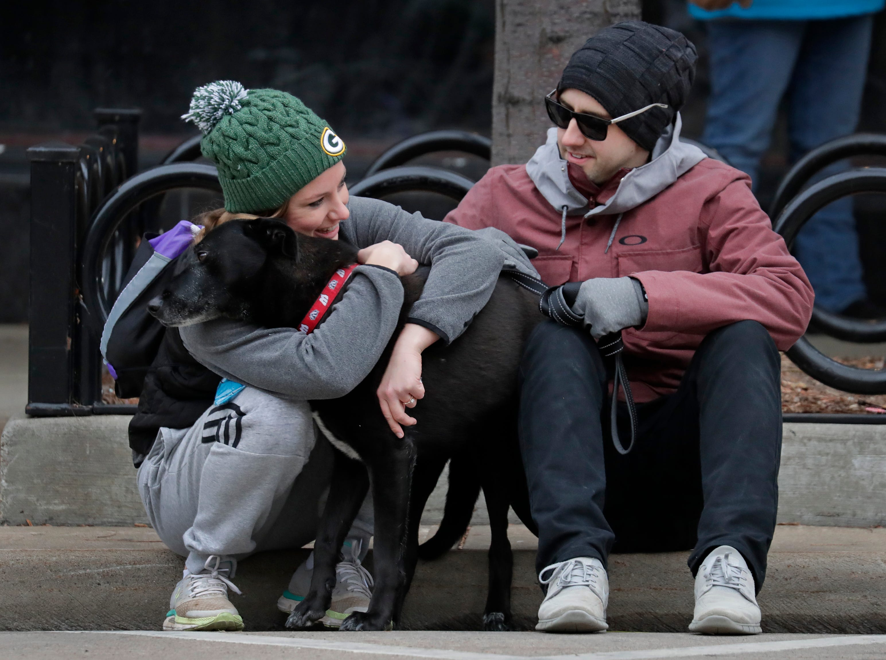 Jessica Becker, left, of Greenville, comforts her dog Buddy prior to running with him during the 11th Annual Festival Foods Turkey Trot Thursday, November 22, 2018, in Appleton, Wis. At right is Jessica's boyfriend David Herrmann of Appleton.