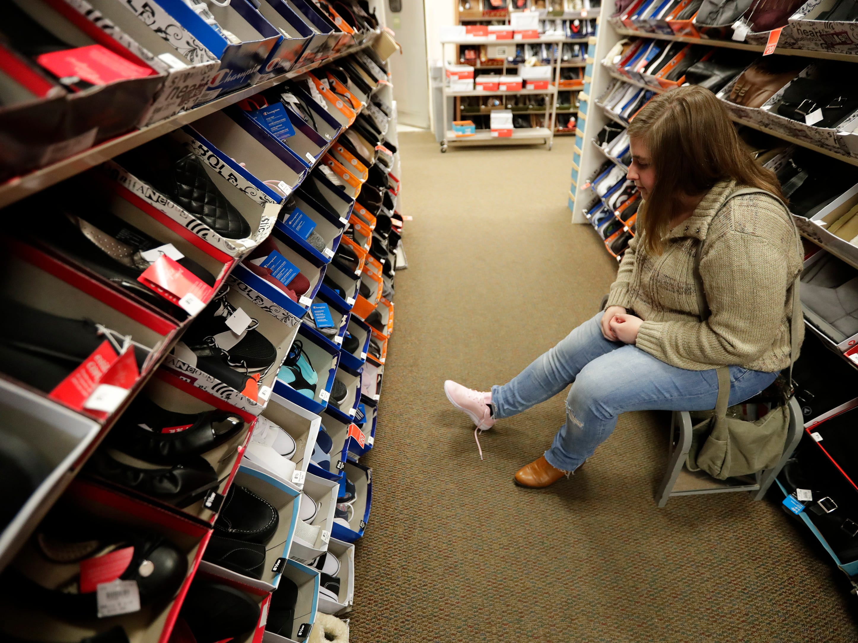 Sarah Pries of Appleton tries on shoes that are Black Friday specials at Shopko Thursday, November 22, 2018, in Appleton, Wis. 