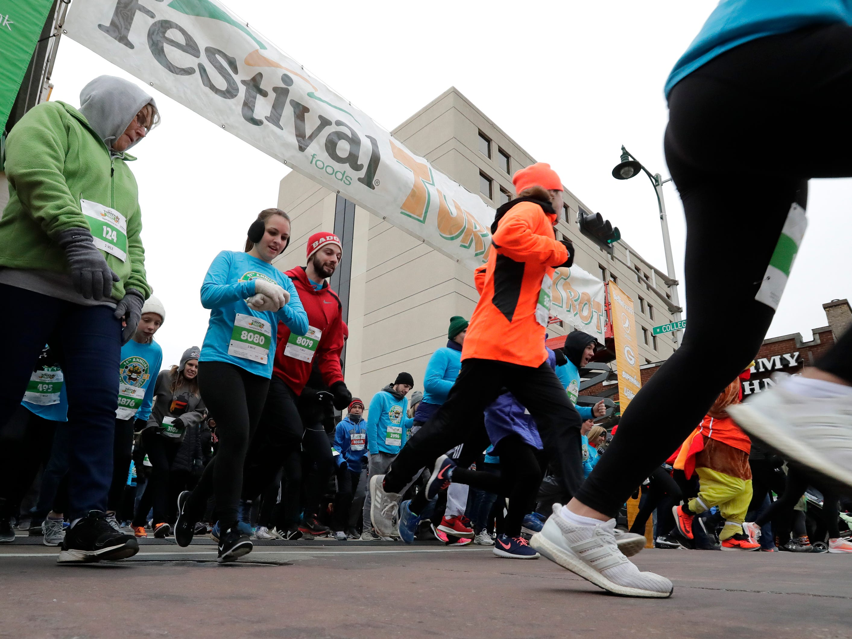 Participants take off from the starting line during the 11th Annual Festival Foods Turkey Trot Thursday, November 22, 2018, in Appleton, Wis. 