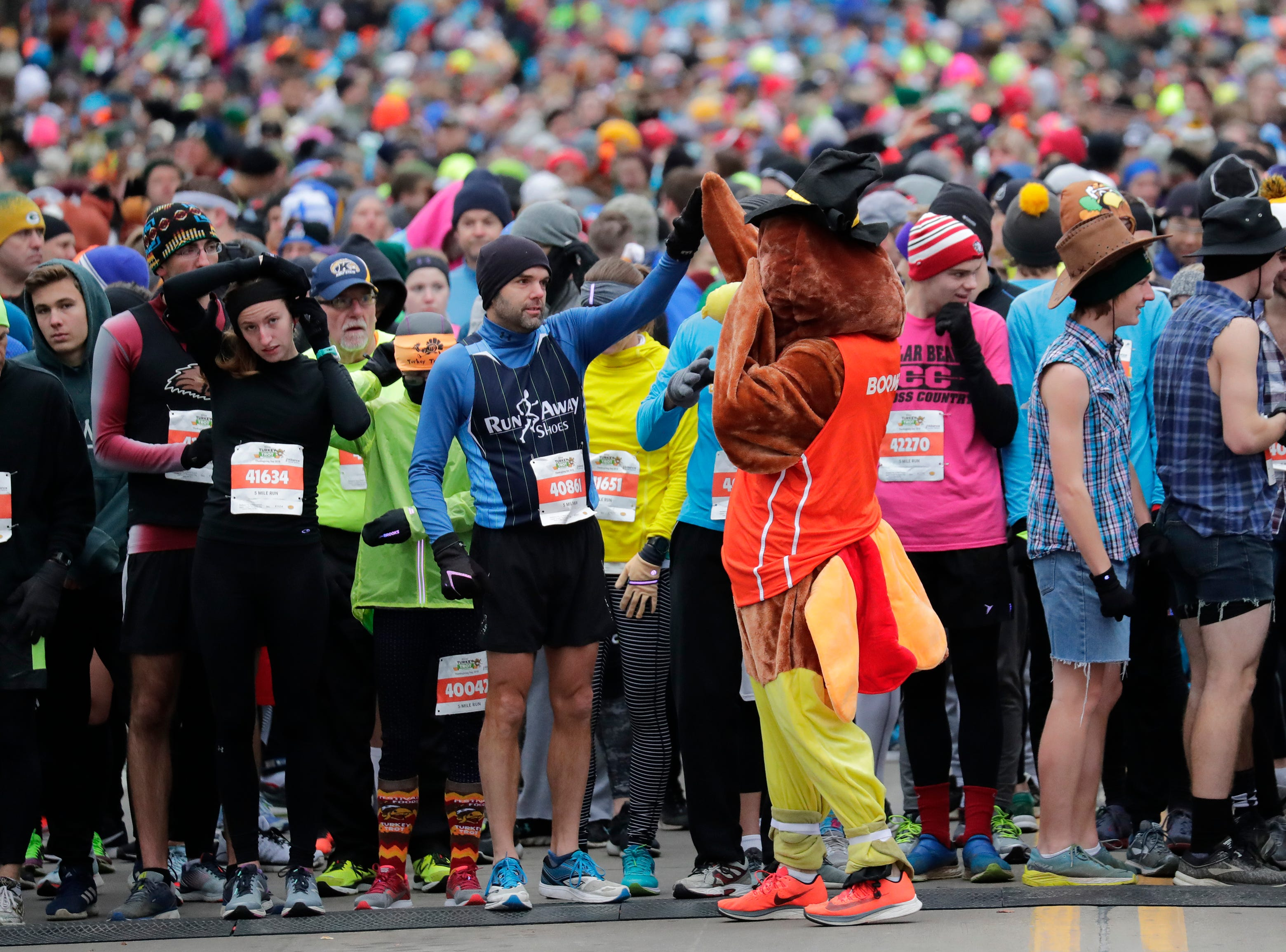 Partipants get ready to take off for 11th Annual Festival Foods Turkey Trot Thursday, November 22, 2018, in Appleton, Wis. 