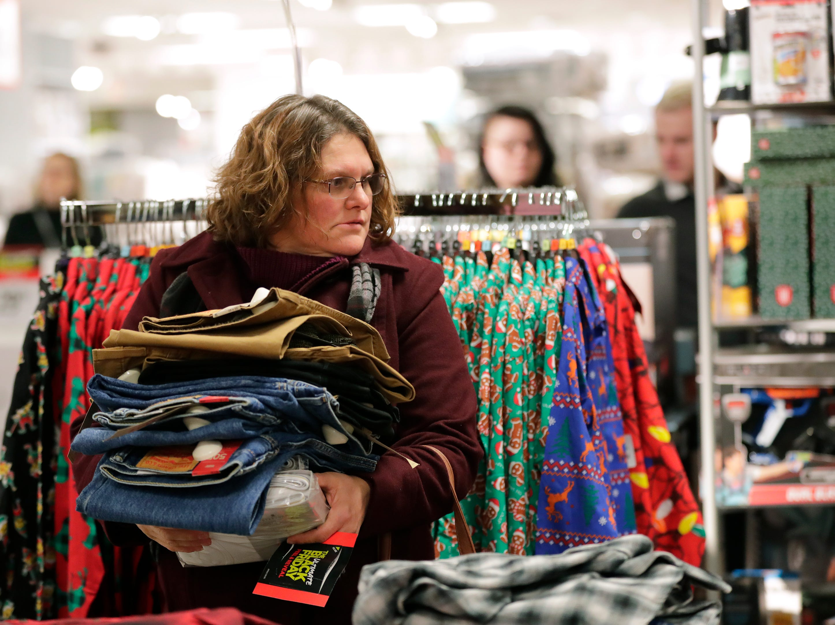 Jean Kempf of Appleton is loaded down with goods as she shops for Black Friday deals at JCPenney Thursday, November 22, 2018, in Grand Chute, Wis. 