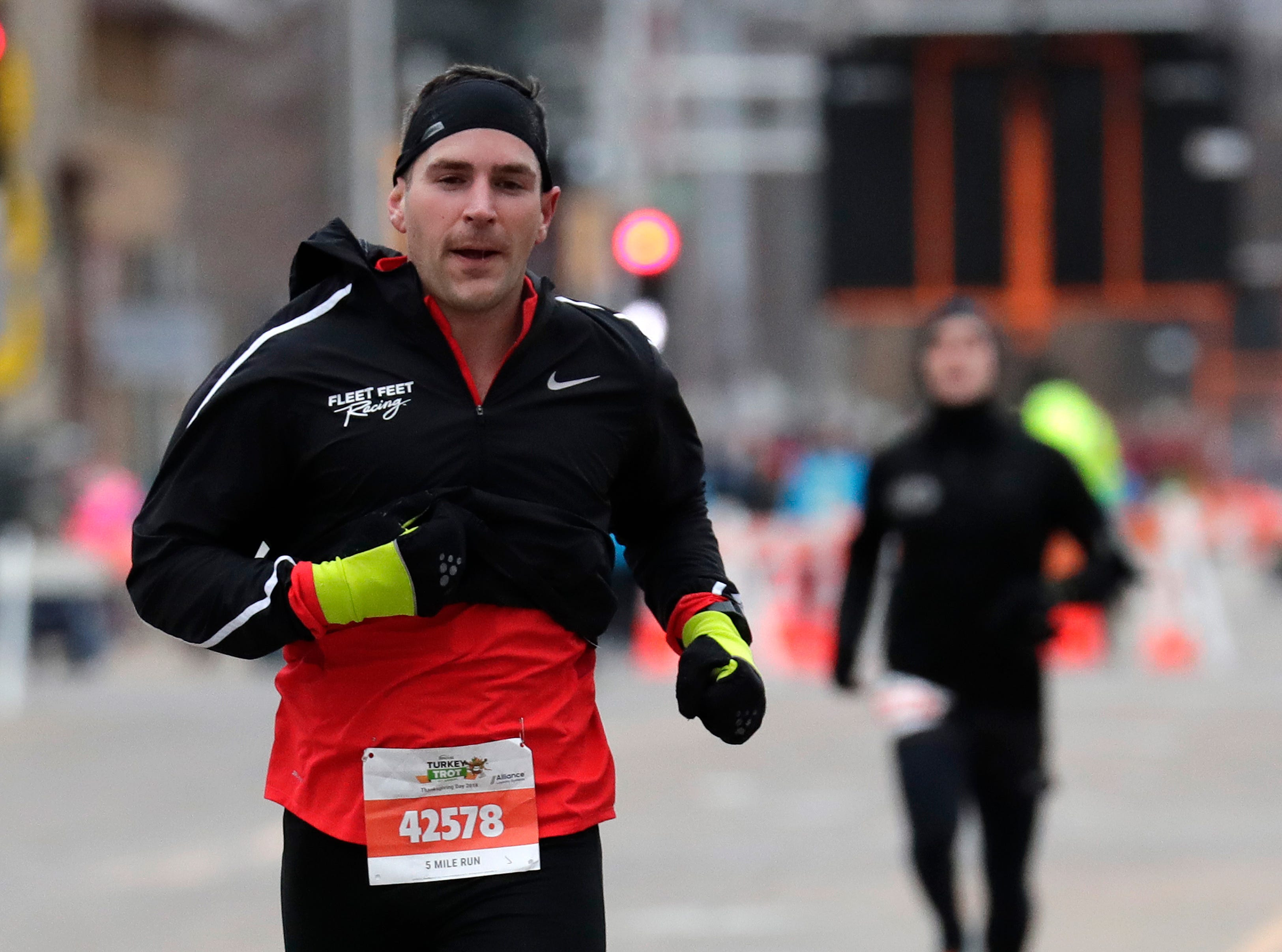 Eric Baum of Chicago participates in the 11th Annual Festival Foods Turkey Trot Thursday, November 22, 2018, in Appleton, Wis. 