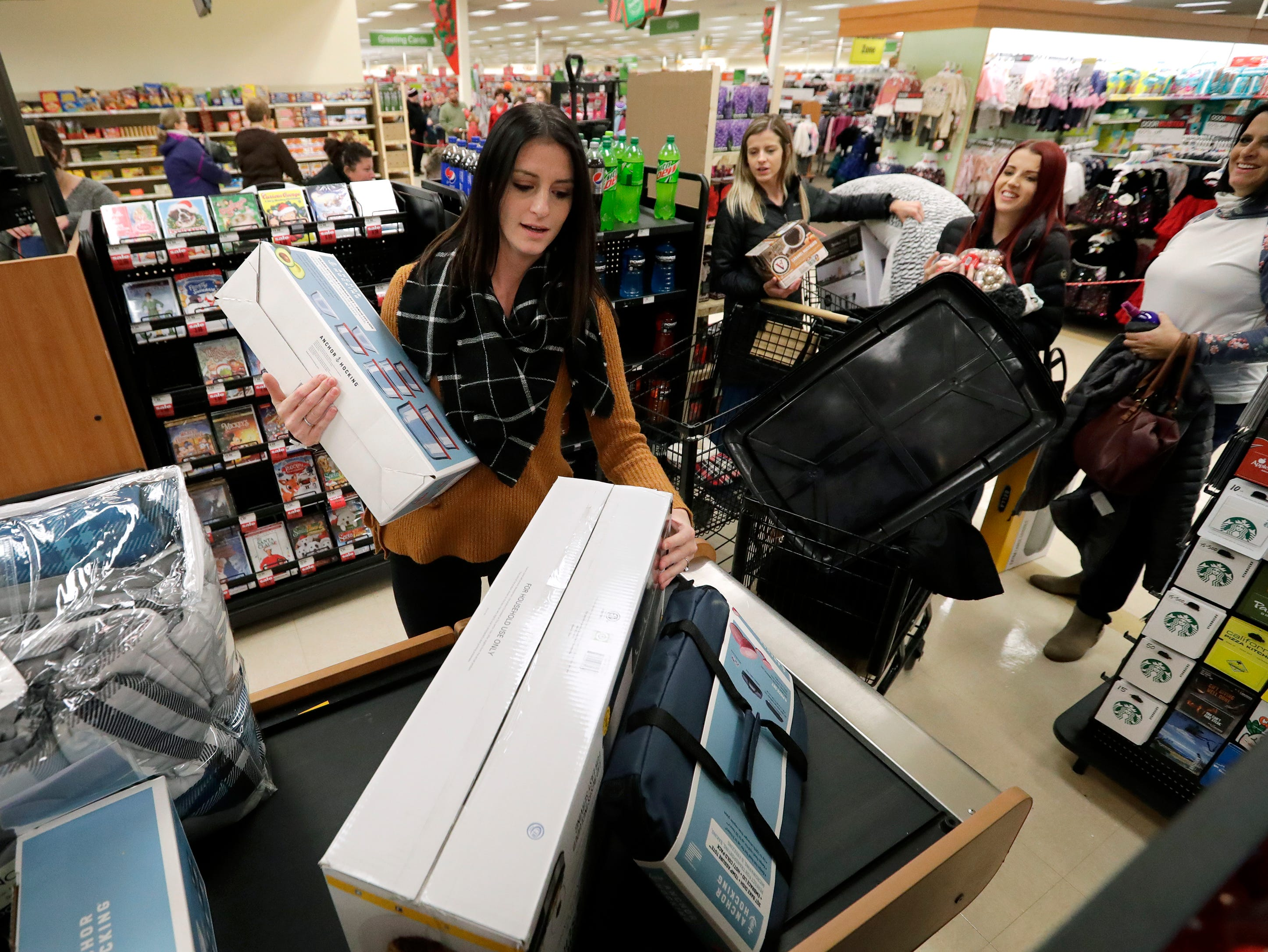 Kayla Williams, left, of Neenah has fun purchasing Black Friday specials with her sisters Kiera Miller of Appleton, Kendra Miller of Appleton and their mother Kelly Miller, far right, of Appleton Thursday, November 22, 2018, at Shopko in Appleton, Wis. 