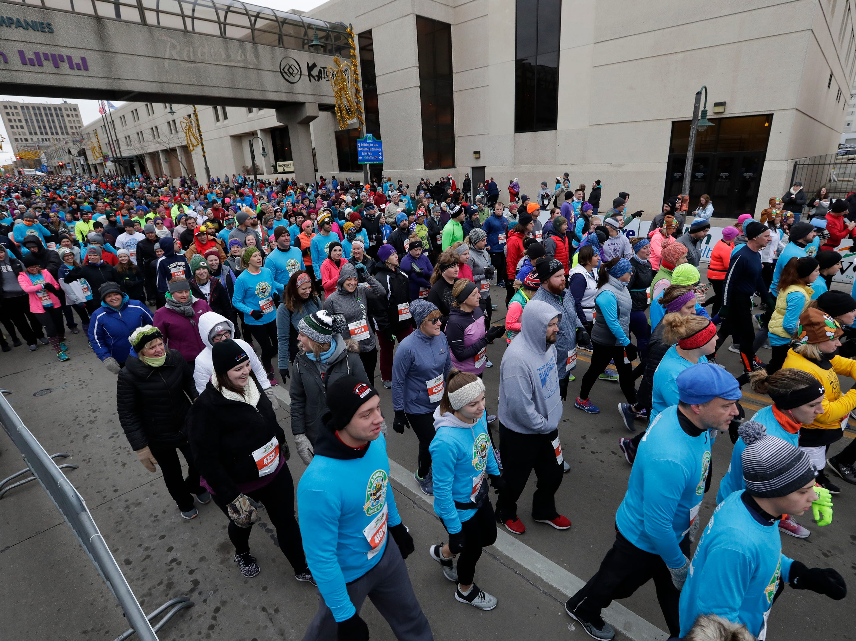 Participants take off during the two-mile portion of the 11th Annual Festival Foods Turkey Trot Thursday, November 22, 2018, in Appleton, Wis. 