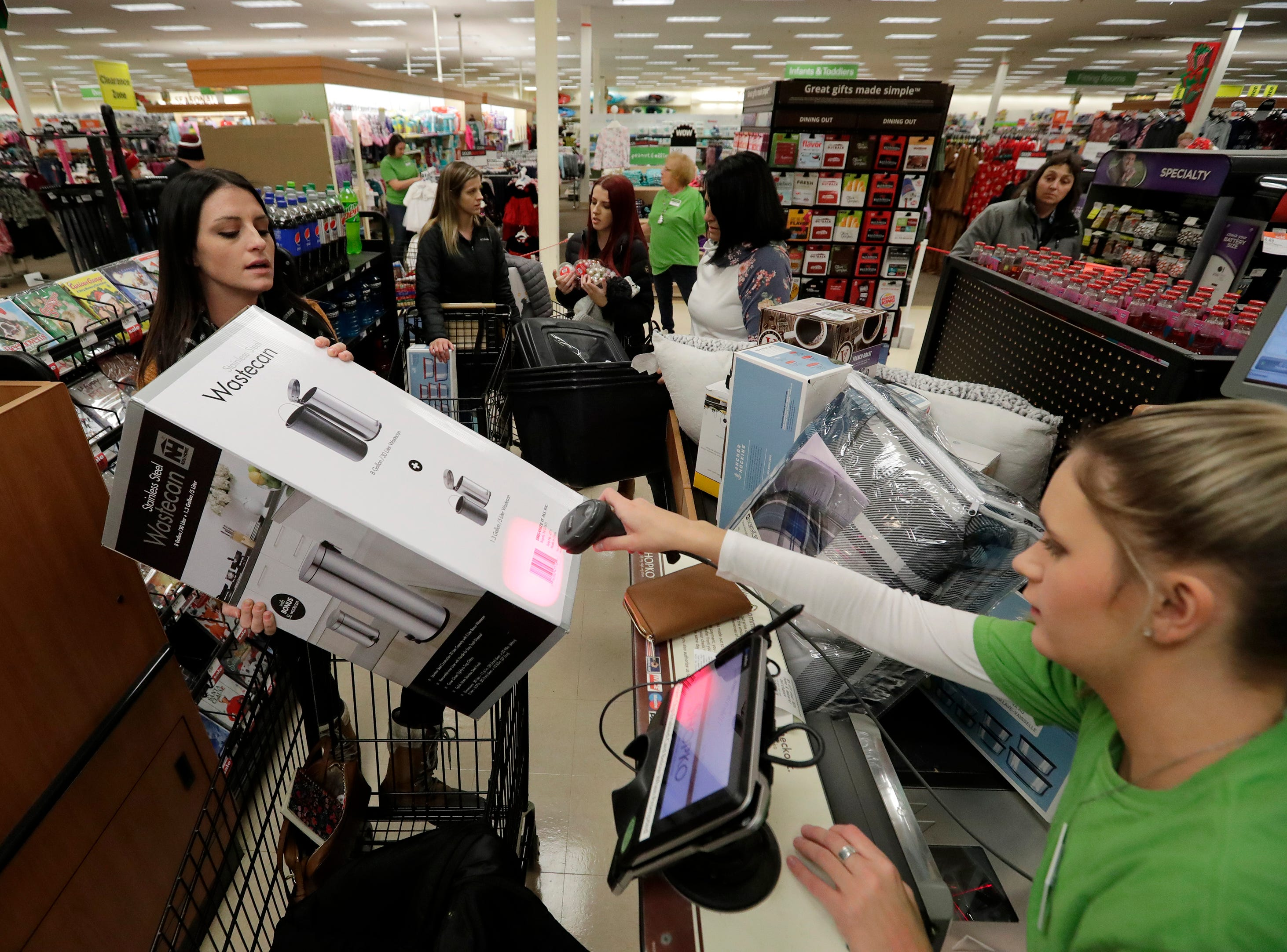 Kayla Williams, left, of Neenah has her Black Friday purchases rung up by Shopko employee Kiarra Springstroh Thursday, November 22, 2018, in Appleton, Wis. 