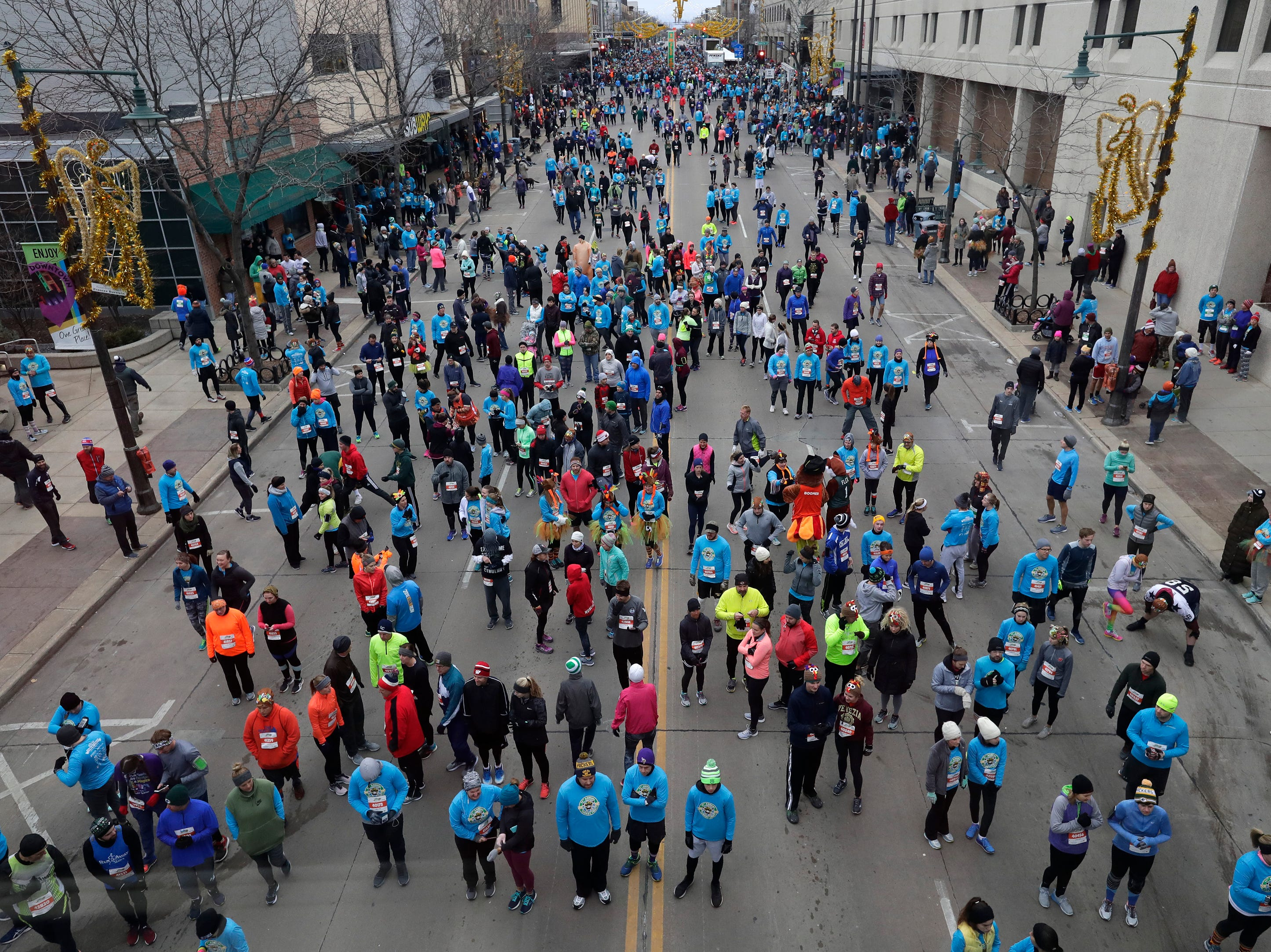Participants begin to make their way to the starting line of the 11th Annual Festival Foods Turkey Trot Thursday, November 22, 2018, in Appleton, Wis. 