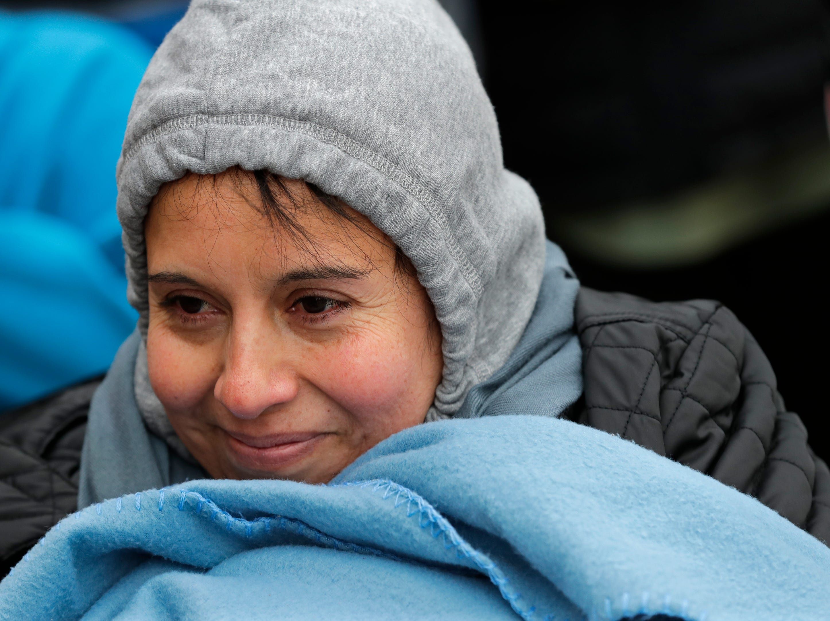 Maria Arrayo of Menasha tries to stay warm while waiting outside in line for Black Friday deals at JCPenney Thursday, November 22, 2018, in Grand Chute, Wis. 