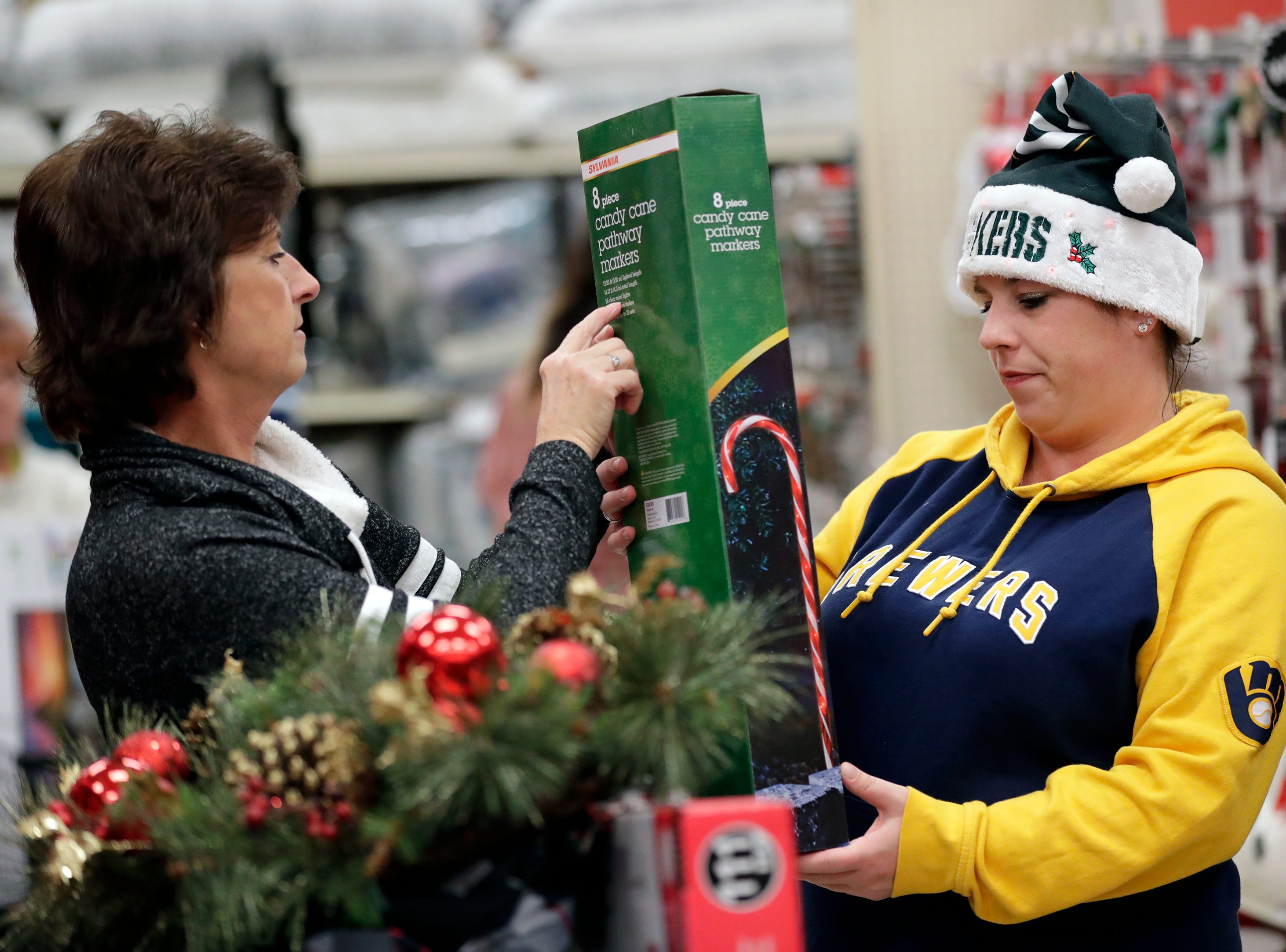 Jeanine Brown, left, of Hortonville and her daughter Pamela Brown of Appleton shop for candy cane pathway markers while looking for Black Friday specials Thursday, November 22, 2018, at Shopko in Appleton, Wis. 