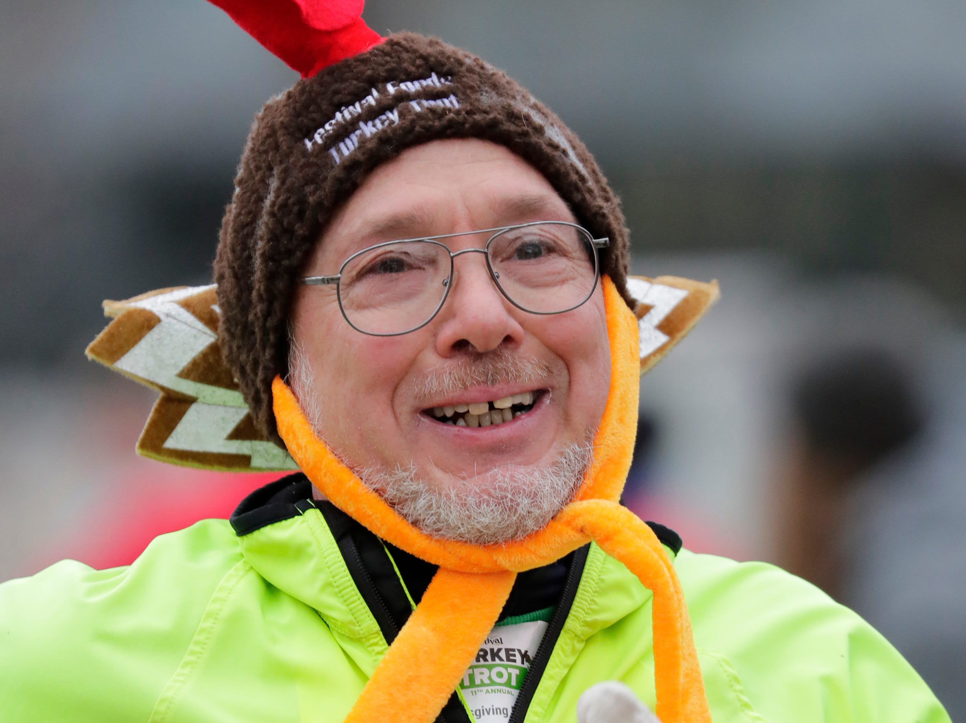 A participant has his eyes on the finish line during the 11th Annual Festival Foods Turkey Trot Thursday, November 22, 2018, in Appleton, Wis. 